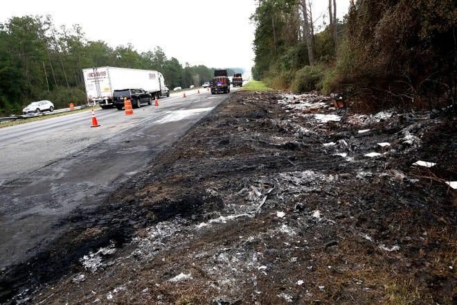 Debris off the south bound side of Interstate 75 remains at the scene of Thursday's multi-vehicle accident that caused multiple fatalities between Alachua and Gainesville, Fla., on Friday, Jan. 4, 2019.