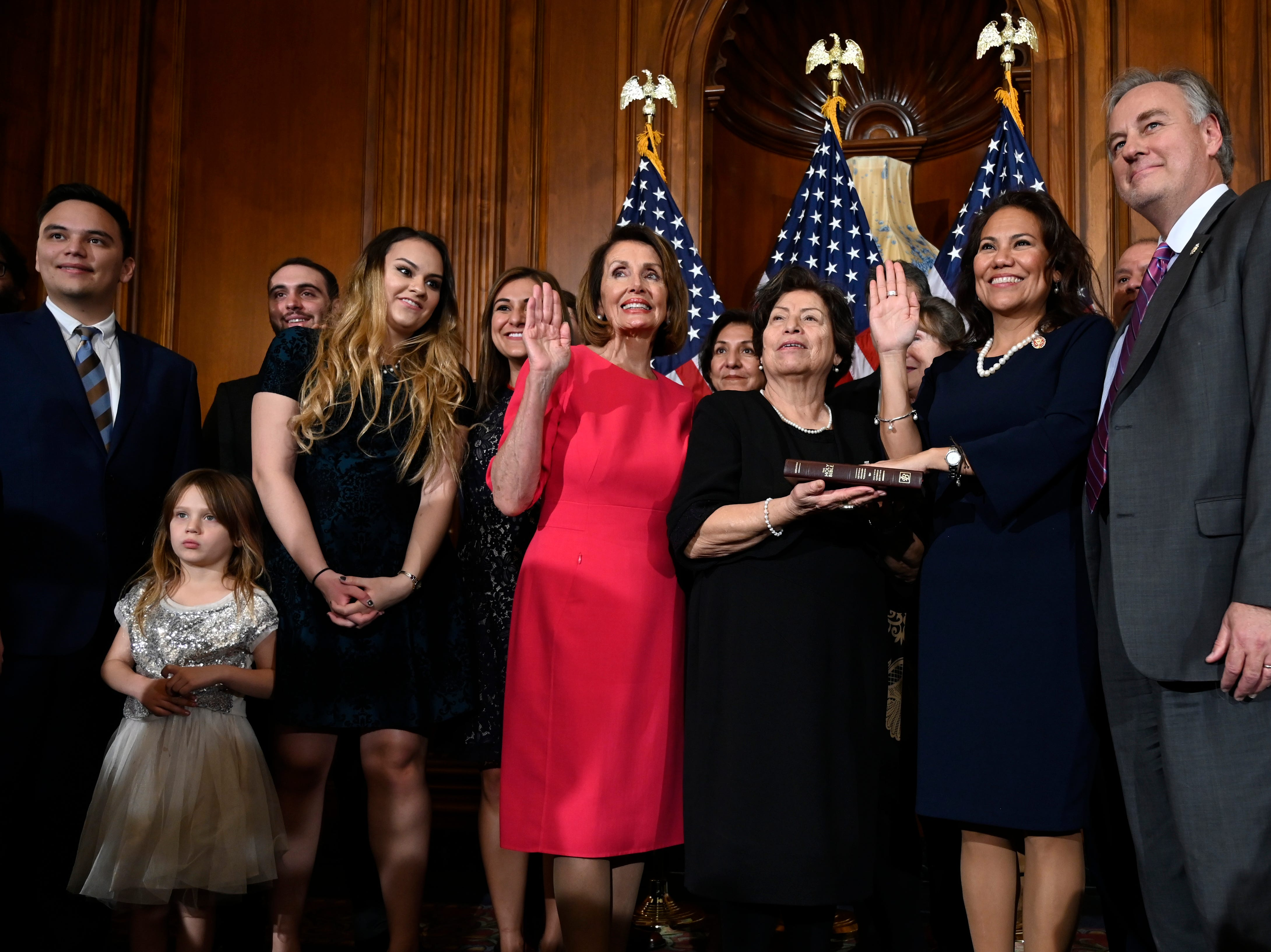 House Speaker Nancy Pelosi of California, left, poses during a ceremonial swearing-in with U.S. Rep. Veronica Escobar, D-El Paso, on Capitol Hill in Washington on Thursday, Jan. 3, 2019, during the opening session of the 116th Congress.