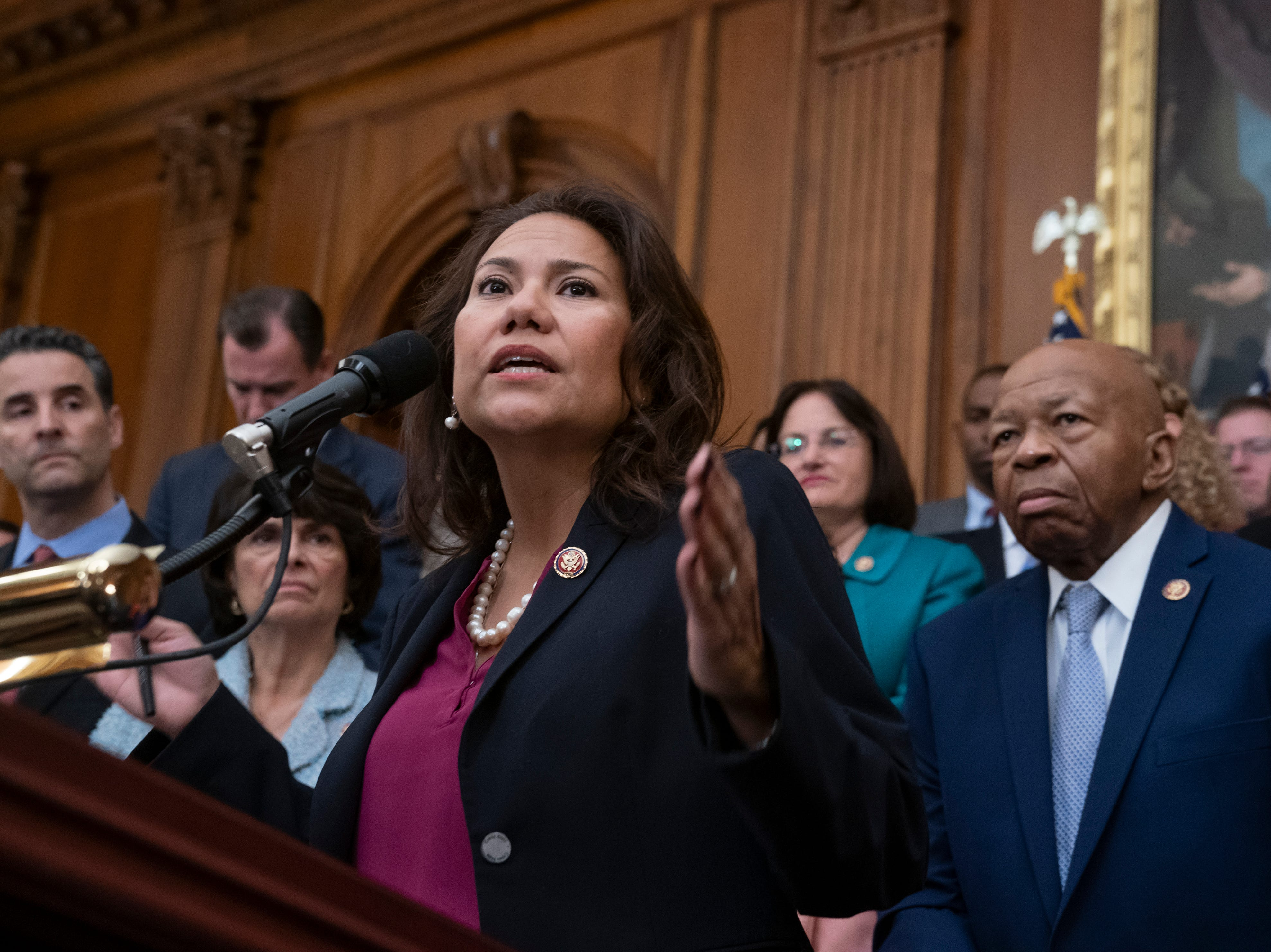 "U.S. Rep. Veronica Escobar, D-El Paso, is joined at right by U.S. Rep. Elijah Cummings, D-Md., chairman of the House Committee on Oversight and Reform, as she speaks as House Democrats unveil a comprehensive elections and ethics reform package that targets what they call a ""culture of corruption in Washington,"" at the Capitol in Washington on Friday, Jan. 4, 2019."