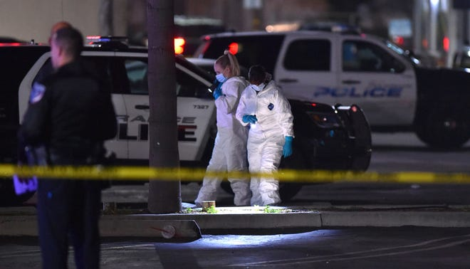Torrance police officers investigate a shooting at the Gable House Bowl on Saturday.  Police responded shortly after midnight to calls of shots fired.