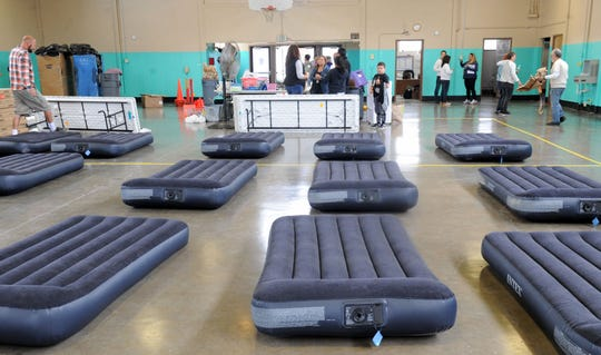 The homeless shelter in Oxnard was ready to operate temporarily Saturday night after a group of volunteers helped clean and paint as a storm approached Ventura County. The 24-hour shelter is expected to open later this month after staff is hired.