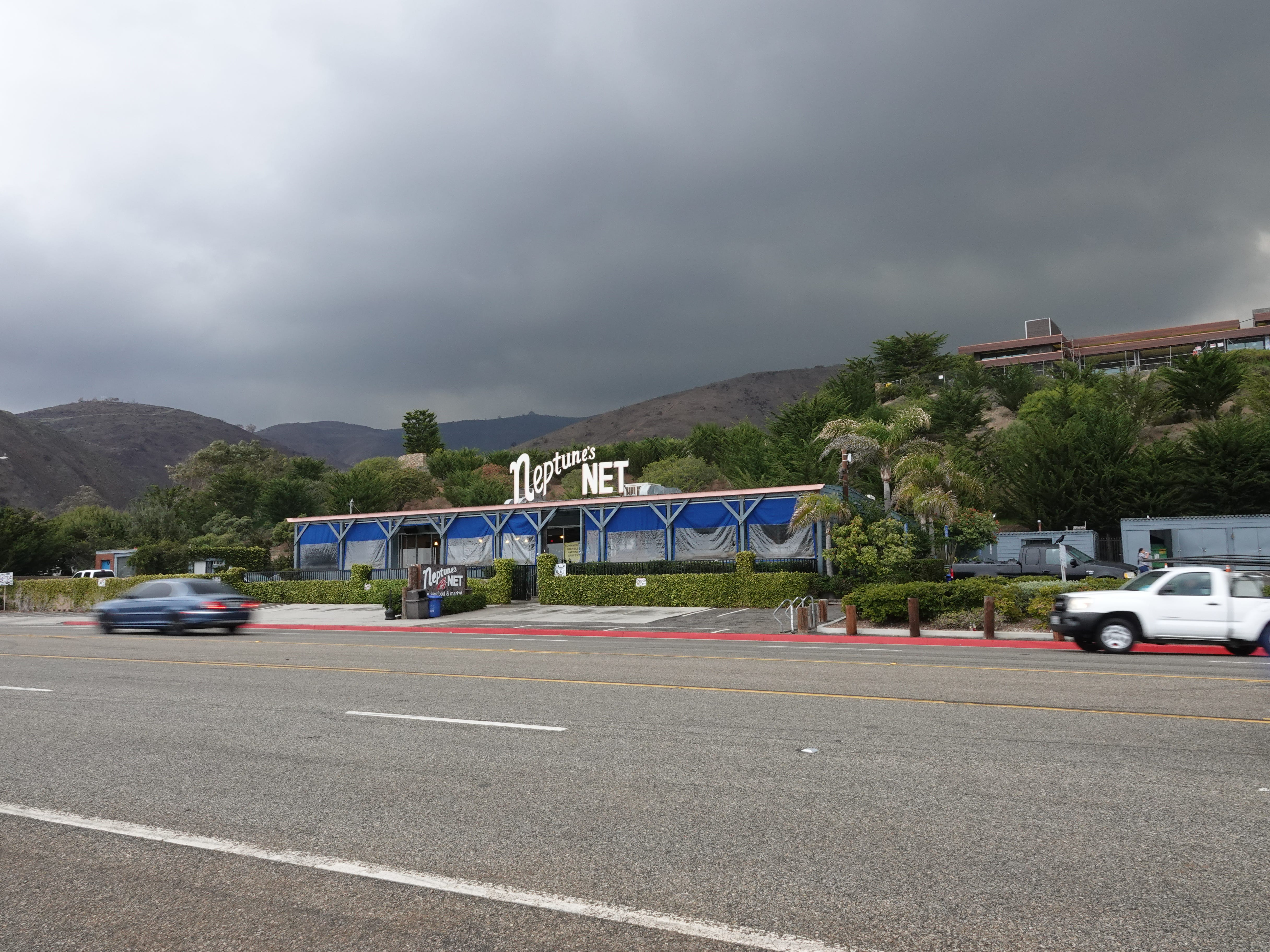 Dark clouds loom behind Neptune's Net on Pacific Coast Highway Saturday as a storm system moved into the area.