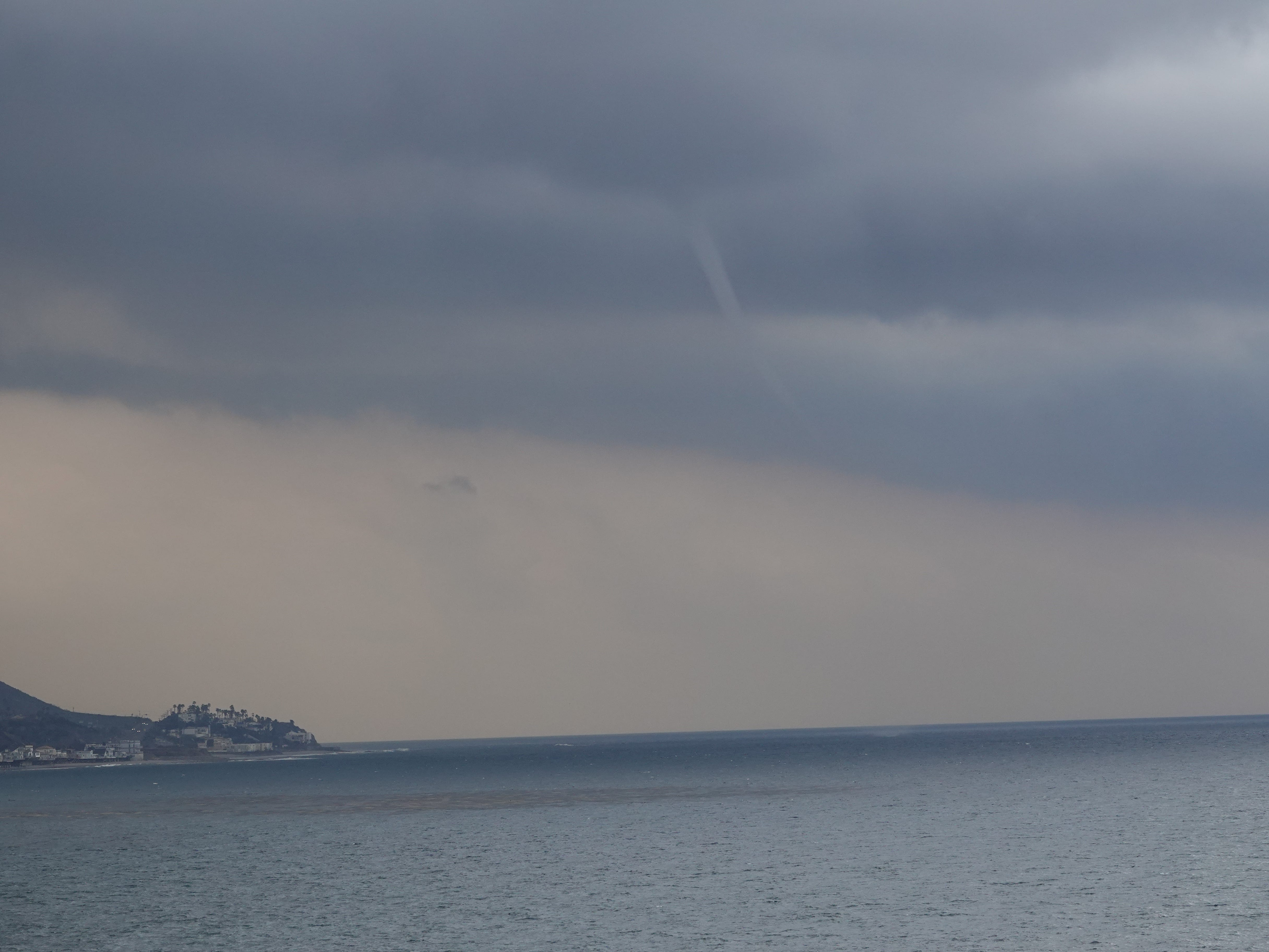 A series of funnel clouds were visible off the Ventura County coast Saturday as a storm system moved into the area, as seen here off Pacific Coast Highway south of Mugu Rock.