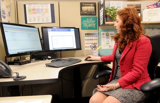 Brittany Stephens, a senior accounting assistant for the county of Ventura, processes bills electronically.