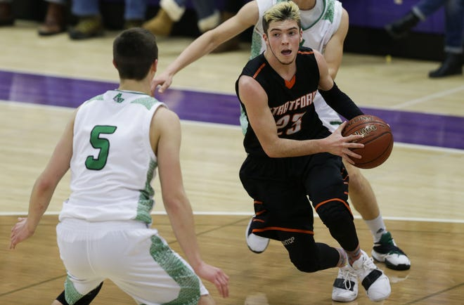 Stratford's Lance Heidmann drives to the basket against Almond-Bancroft during the Sentry Classic last weekend at the University of Wisconsin-Stevens Point. The Tigers head to Auburndale for a Marawood Conference-South Division showdown this week.