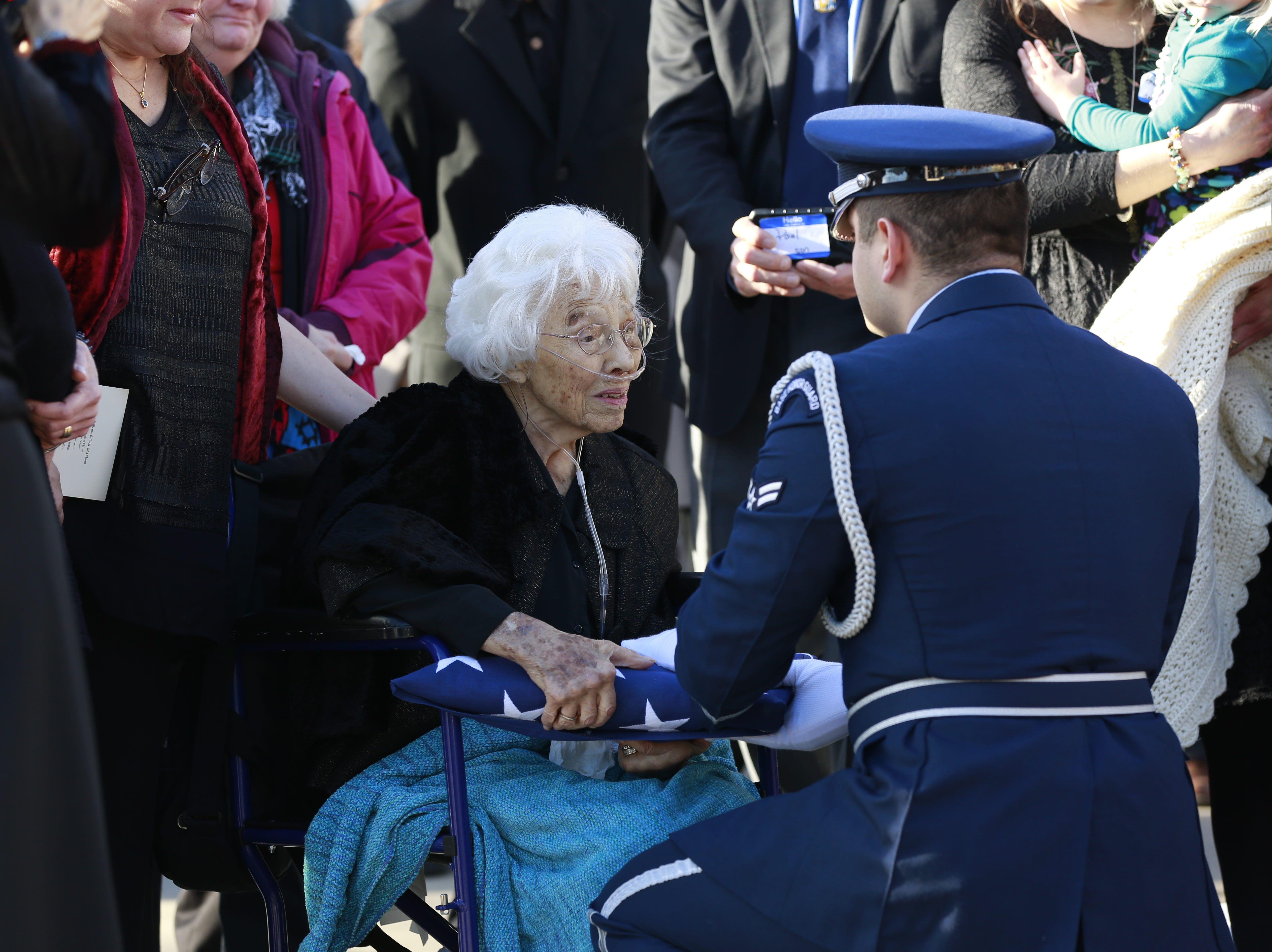 United States Air Force presents the burial flag to former Sen. Walter Chilsen's wife Rose during Sen. Walter Chilsen's funeral service Friday, Jan. 04, 2019, at Holy Name of Jesus Parish in Wausau, Wisc. T'xer Zhon Kha/USA TODAY NETWORK-Wisconsin