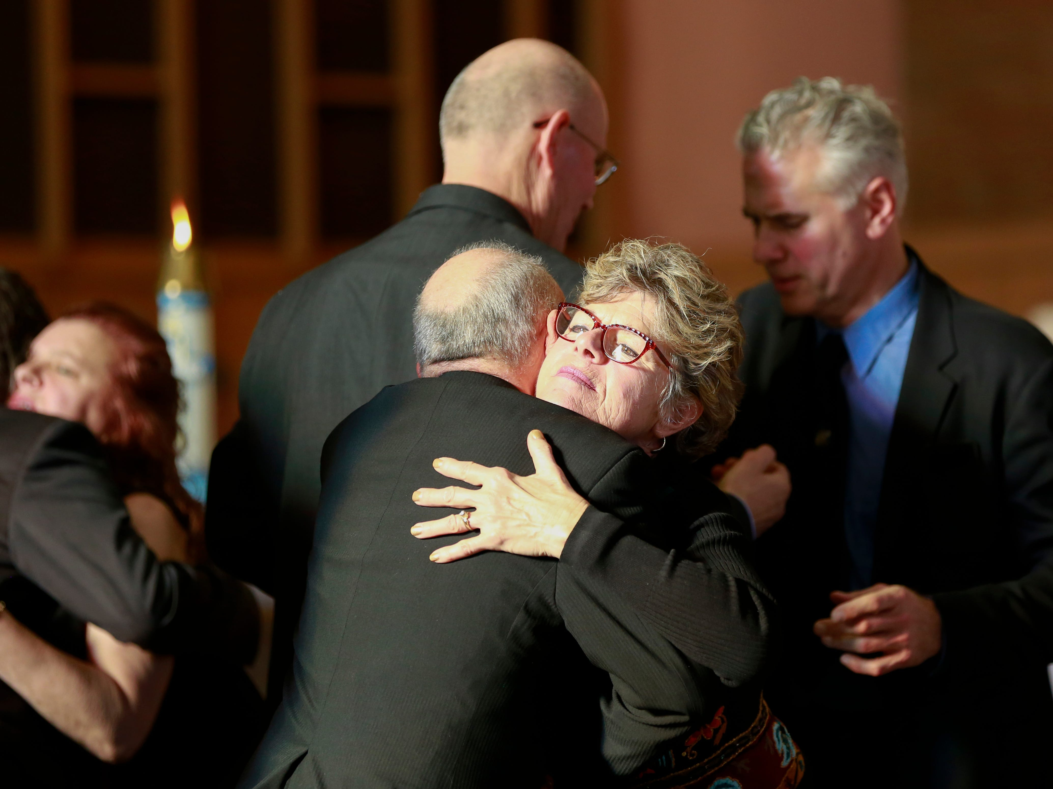 Family members embrace each other during former Sen. Walter Chilsen's funeral service Friday, Jan. 04, 2019, at Holy Name of Jesus Parish in Wausau, Wisc. T'xer Zhon Kha/USA TODAY NETWORK-Wisconsin