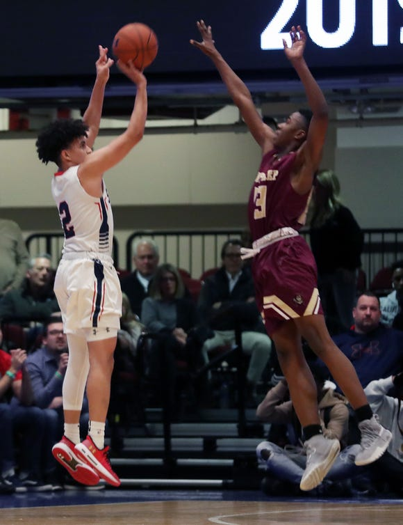 Stepinac's Eduard Mindya (2) puts up a shot in front of Iona's Ronald Greene Jr. (13) during the Crusader Classic at the Westchester County Center in White Plains Jan. 4, 2019. Iona won the game 60-55.