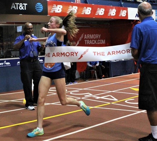Lily Flynn of Ursuline hits tape to win 2019 Hispanic Games 3000.