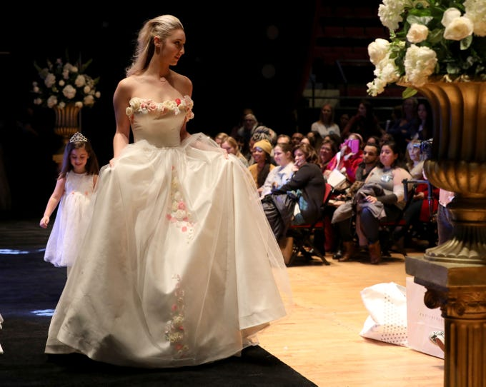 Wedding gowns from Geraldina's Couture in Hartsdale are displayed, during a fashion show at the Jenks Productions of the 19th Annual Westchester Wedding & Bridal Expo at the Westchester County Center in White Plains, Jan. 5, 2019.