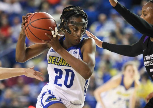 Delaware's Jasmine Dickey works through traffic in the first half of the Hens' opening game in CAA play at the Bob Carpenter Center in January.