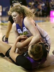 Delaware's Lizzie Oleary (top) tangles with James Madison's Devon Merritt in the first half of the Hens' opening game in CAA play at the Bob Carpenter Center Friday.