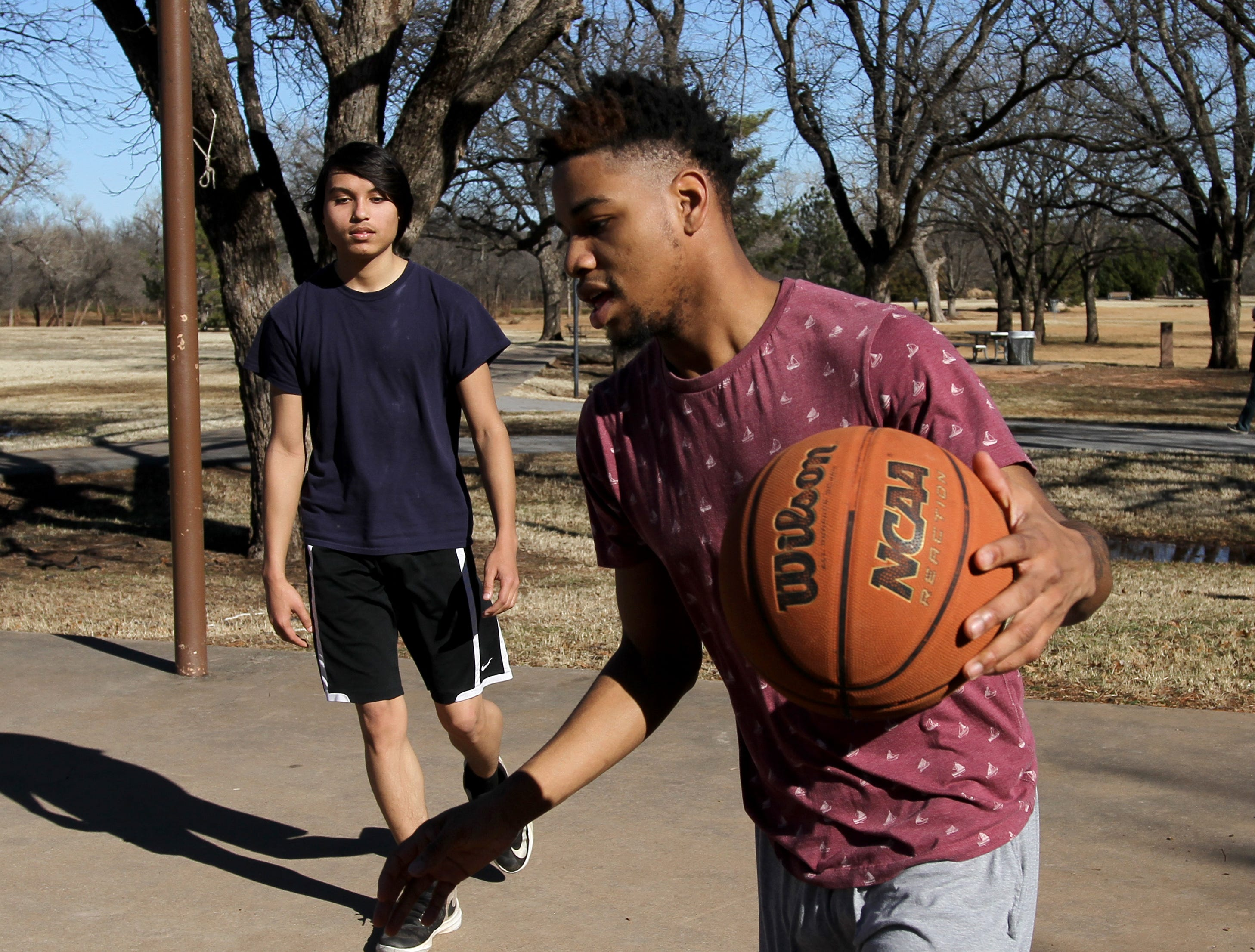 Deonte Thomas, right, and Isaac Mitchell play basketball Saturday, Jan. 5, 2019, in Lucy Park.