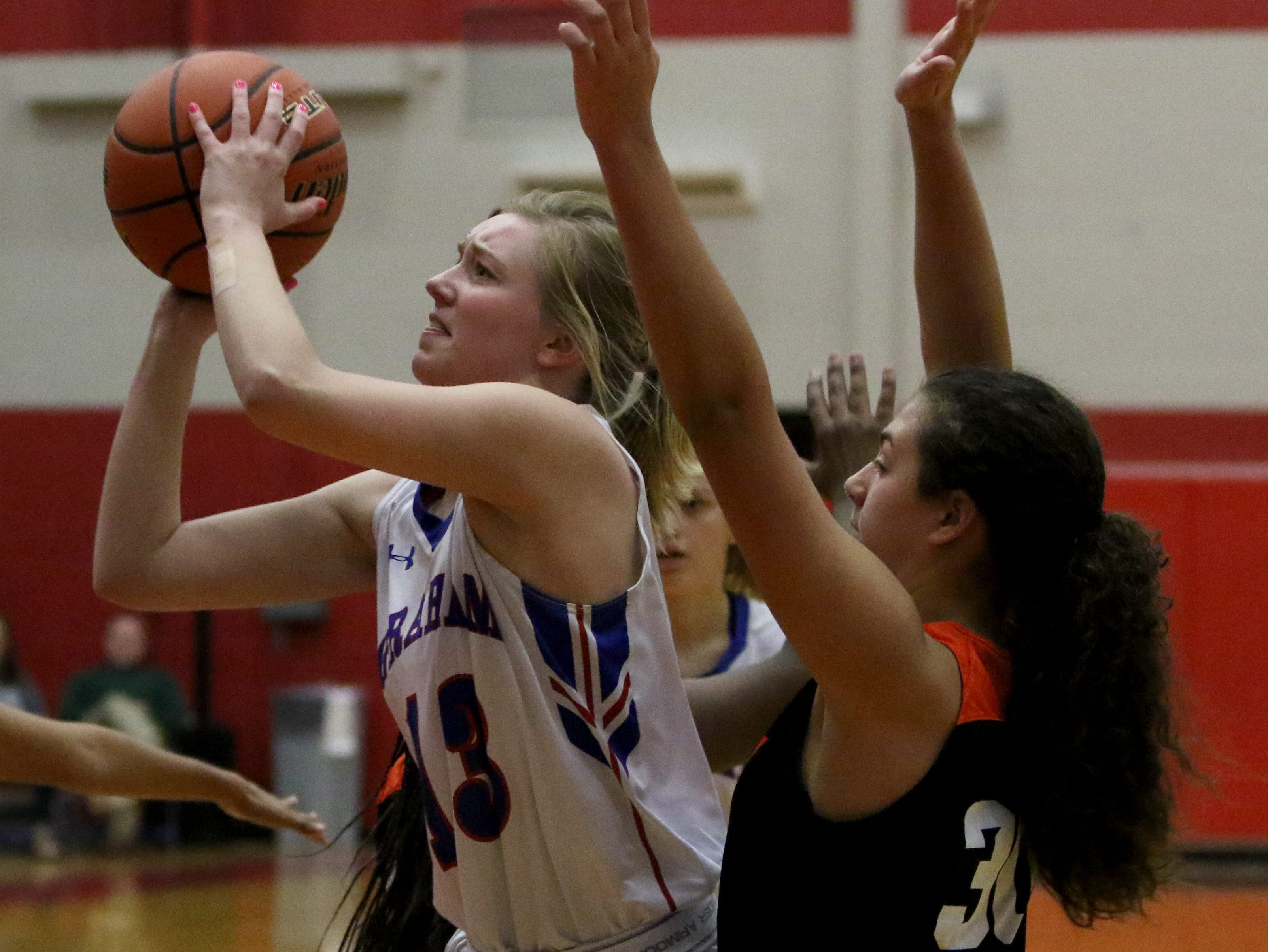 Graham's Trinity Franklin shoots against Burkburnett Friday, Jan. 4, 2019, in Graham. The Lady Blues defeated the Lady Bulldogs 51-33.