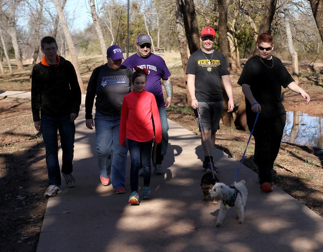 A family takes a walk along the path toward the falls Saturday, Jan. 5, 2019, in Lucy Park.