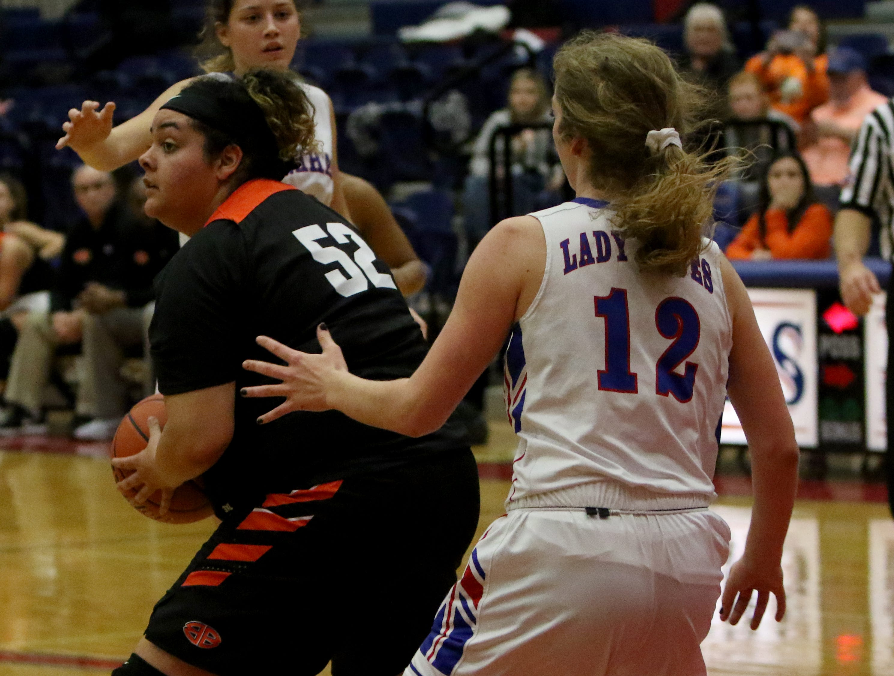Burkburnett's Kerissa Durham looks to a teammate in while guarded by Graham's Emma Ranger Friday, Jan. 4, 2019, in Graham. The Lady Blues defeated the Lady Bulldogs 51-33.