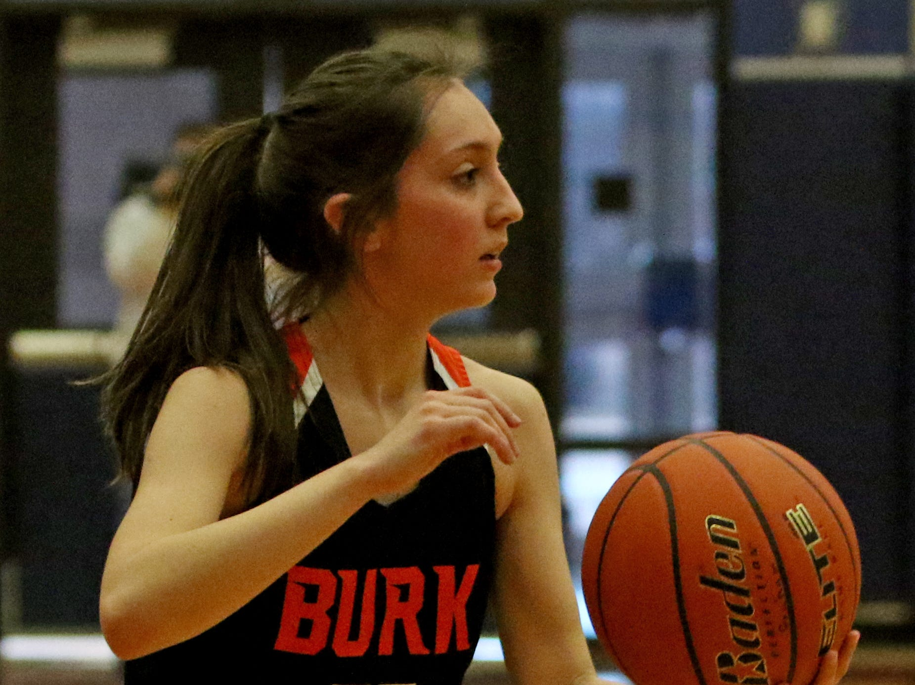 Burkburnett's Sarah Nolan holds the ball in the game against Graham Friday, Jan. 4, 2019, in Graham. The Lady Blues defeated the Lady Bulldogs 51-33.