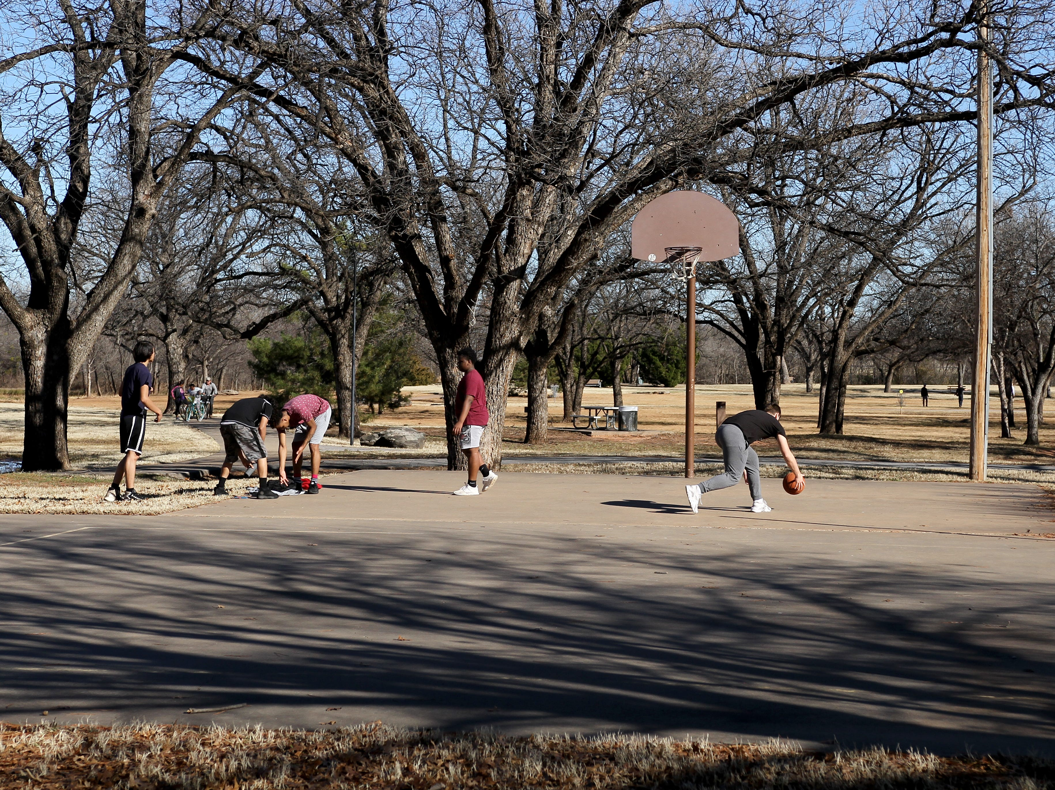People took advantage of the warm weather Saturday, Jan. 5, 2019, by going out to play and walk at Lucy Park.