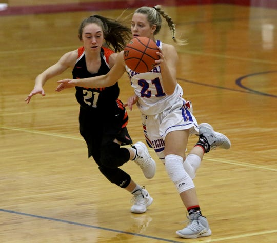 Graham's Ryan Gober dribbles by Burkburnett's Lexi King Friday, Jan. 4, 2019, in Graham. The Lady Blues defeated the Lady Bulldogs 51-33.