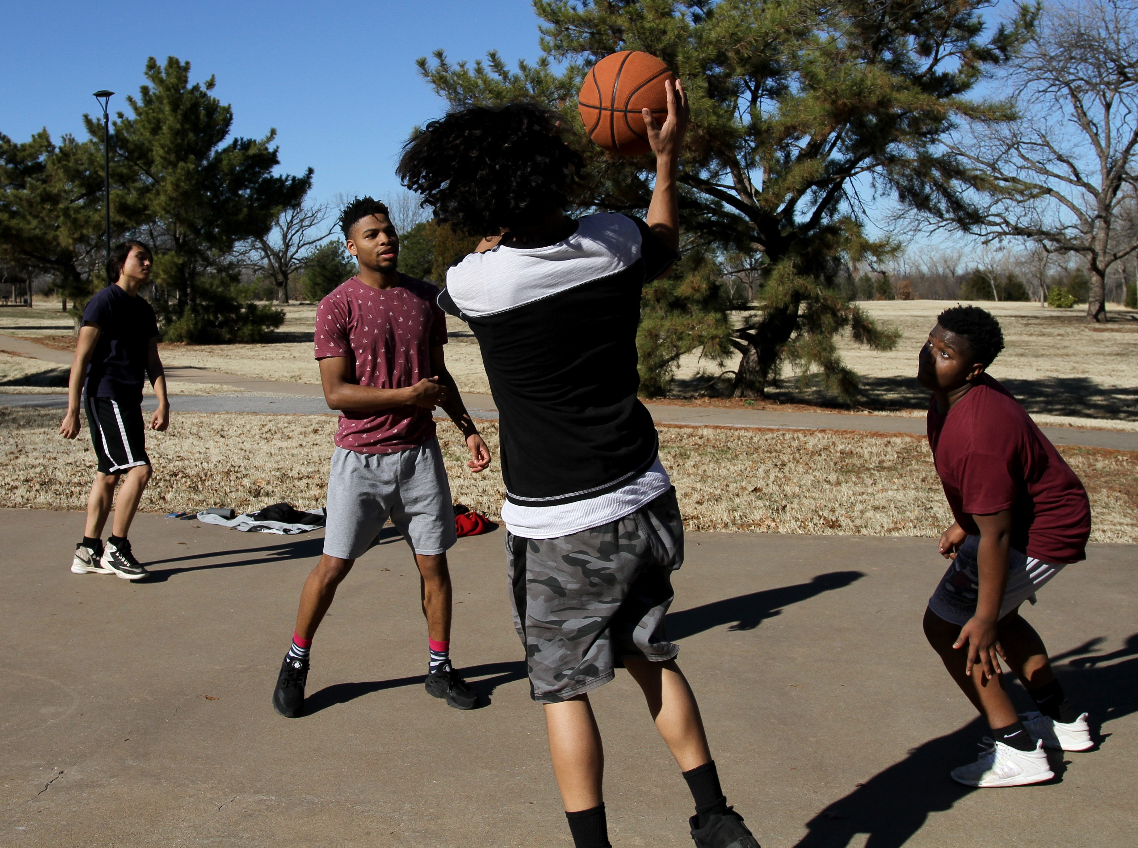 Isaac Mitchell, left, Deonte Thomas, Jacob Ramos and Kaherean Carter play basketball Saturday, Jan. 5, 2019, in Lucy Park.