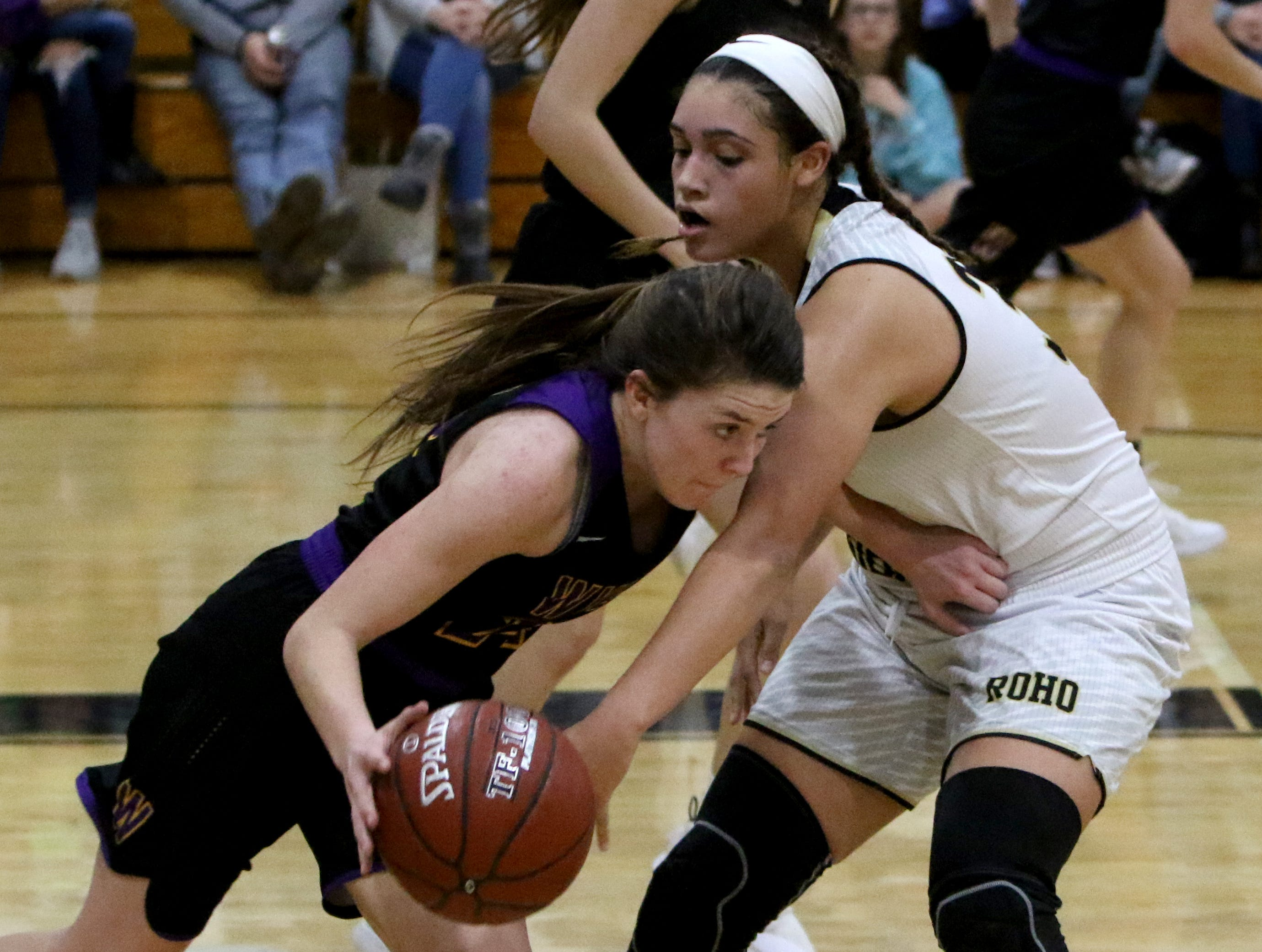 Rider's Addison Self attempts to steal from Abilene Wylie's Mary Lovelace Friday, Jan. 4, 2019 at McNiel Middle School.
