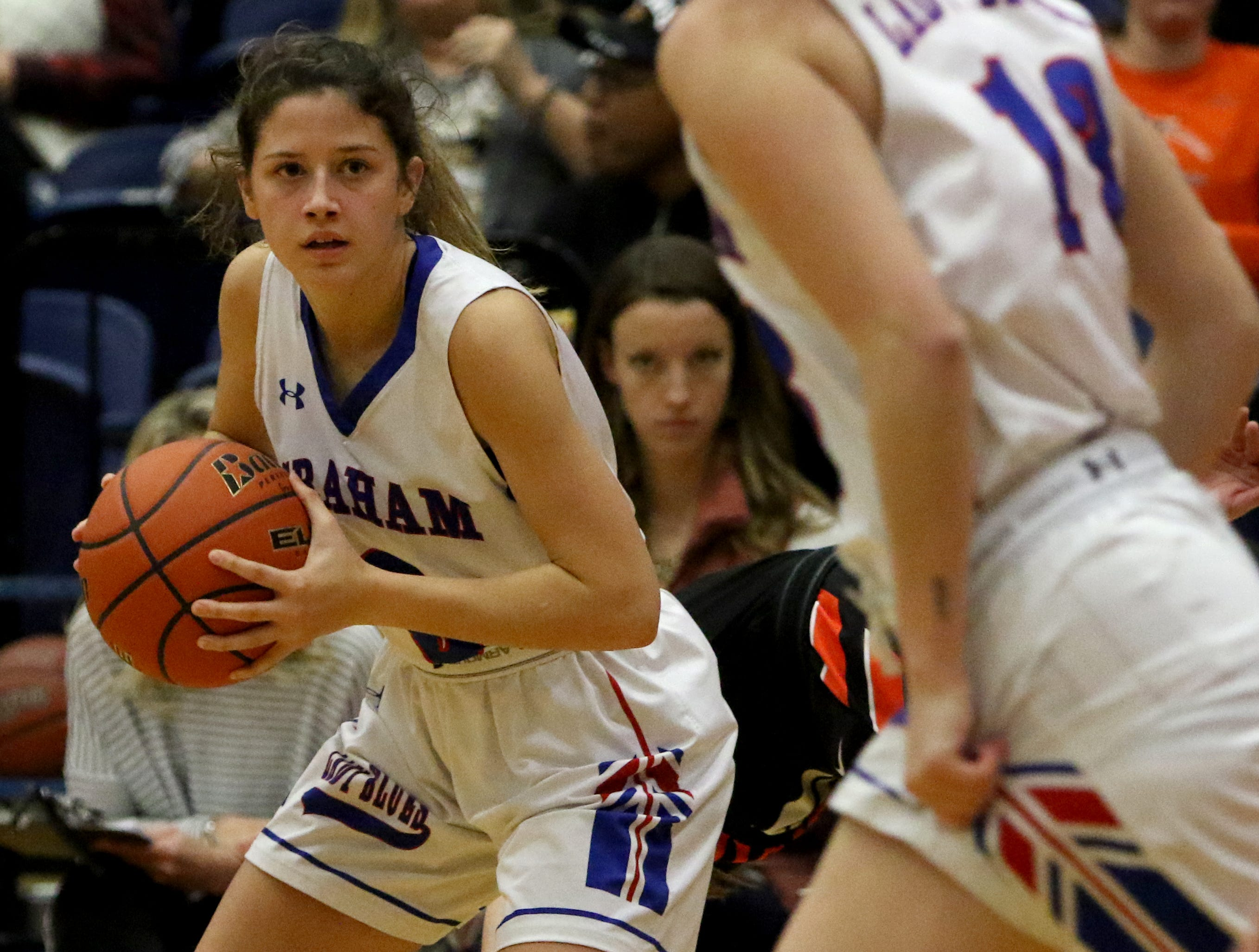 Graham's Michelle Delong looks to a teammate after getting the rebound in the game against Burkburnett Friday, Jan. 4, 2019, in Graham. The Lady Blues defeated the Lady Bulldogs 51-33.