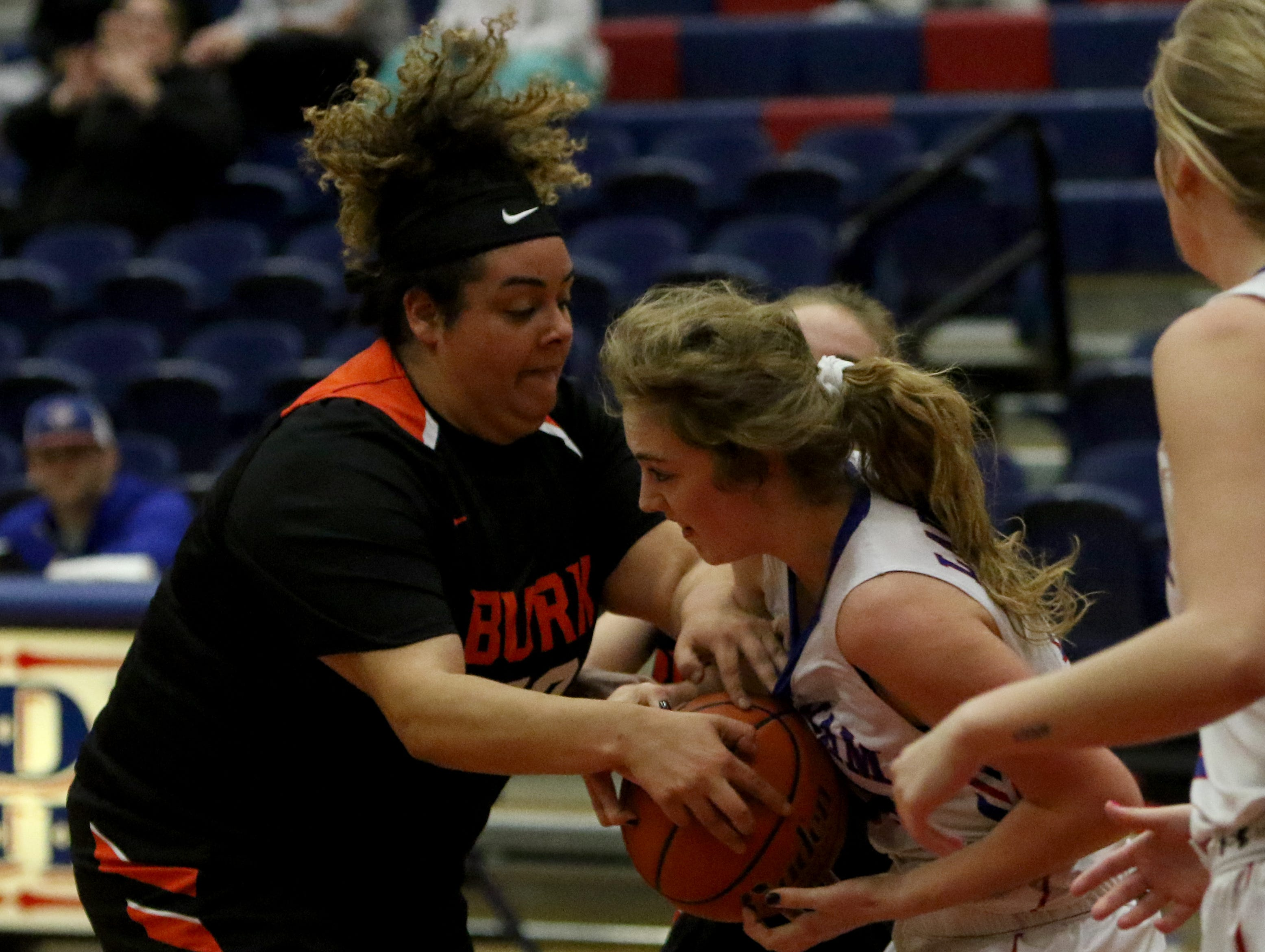 Burkburnett's Kerissa Durham tries to take the ball from Graham's Emma Ranger Friday, Jan. 4, 2019, in Graham. The Lady Blues defeated the Lady Bulldogs 51-33.