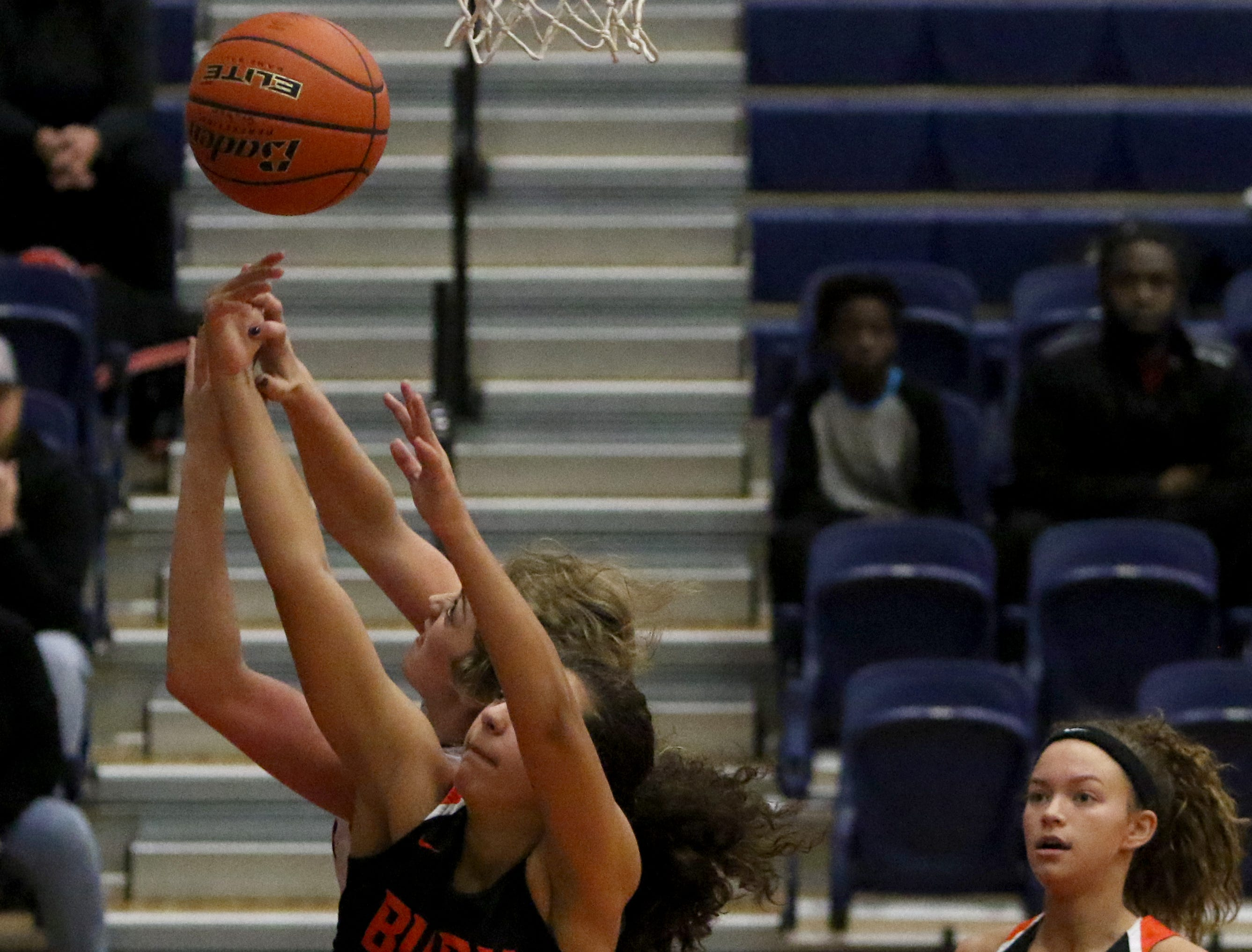 Burkburnett's Raegan King reaches for the rebound in the game against Graham Friday, Jan. 4, 2019, in Graham. The Lady Blues defeated the Lady Bulldogs 51-33.