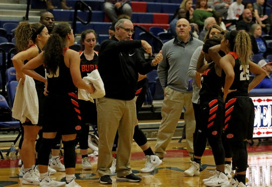 Burkburnett head basketball coach Alex Koulovatos talks to his team during a timeout in the game against Graham Friday, Jan. 4, 2019, in Graham. The Lady Blues defeated the Lady Bulldogs 51-33.