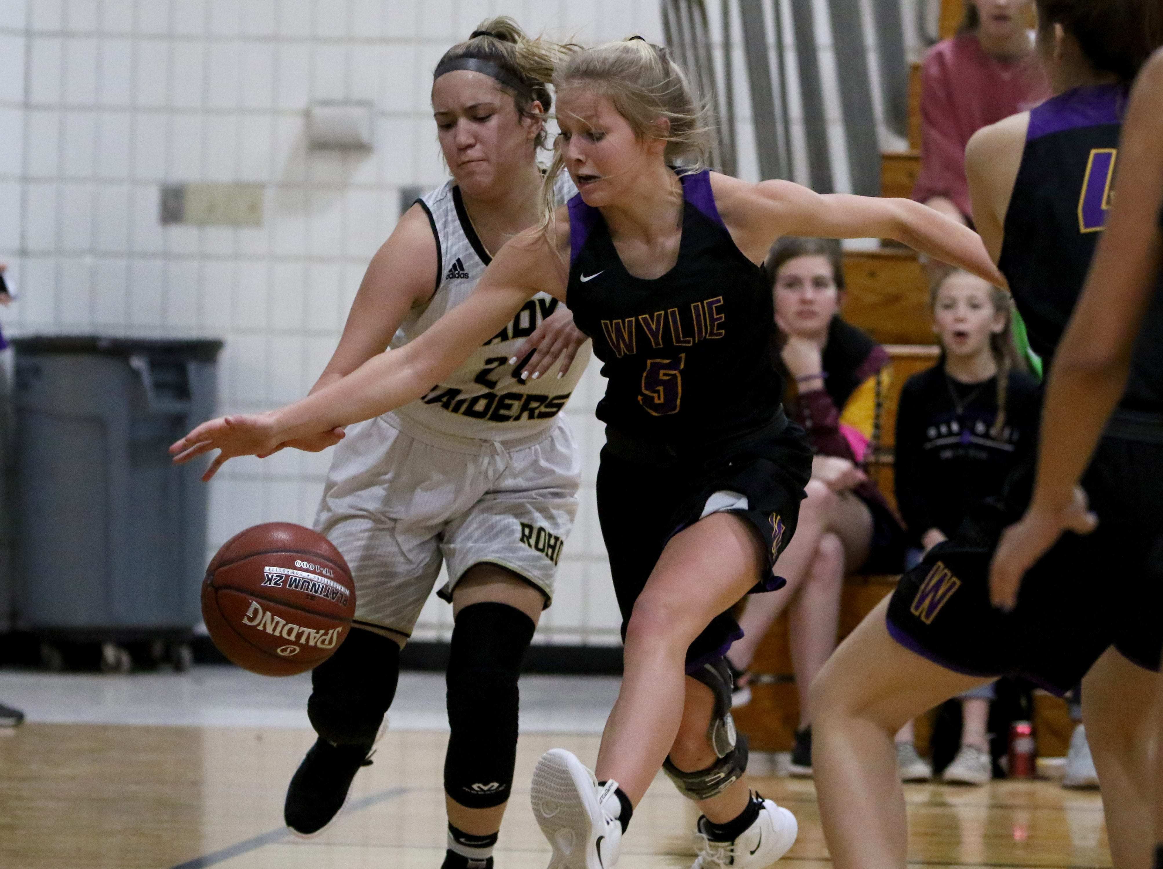 Rider's Atlea Cooke loses the ball to Abilene Wylie's Emma Melton Friday, Jan. 4, 2019 at McNiel Middle School.