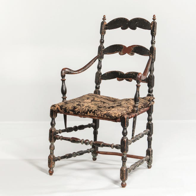 A Canadian slat-back chair is sometimes found in the United States. There were many more chair makers in the United States than in Canada, so the chairs are harder to find. This Canadian chair sold for $1,200, well over the estimated price.
