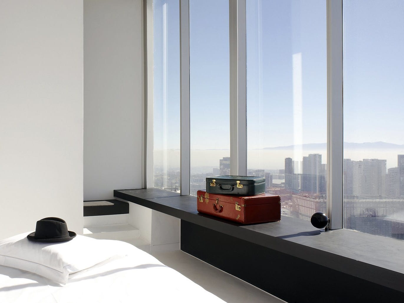 Minimalist glamour in the form of fine finishes, tall ceilings, large windows and white walls is found at the Distrito Capital Hotel in Mexico City's skyscraper district, Santa Fe.