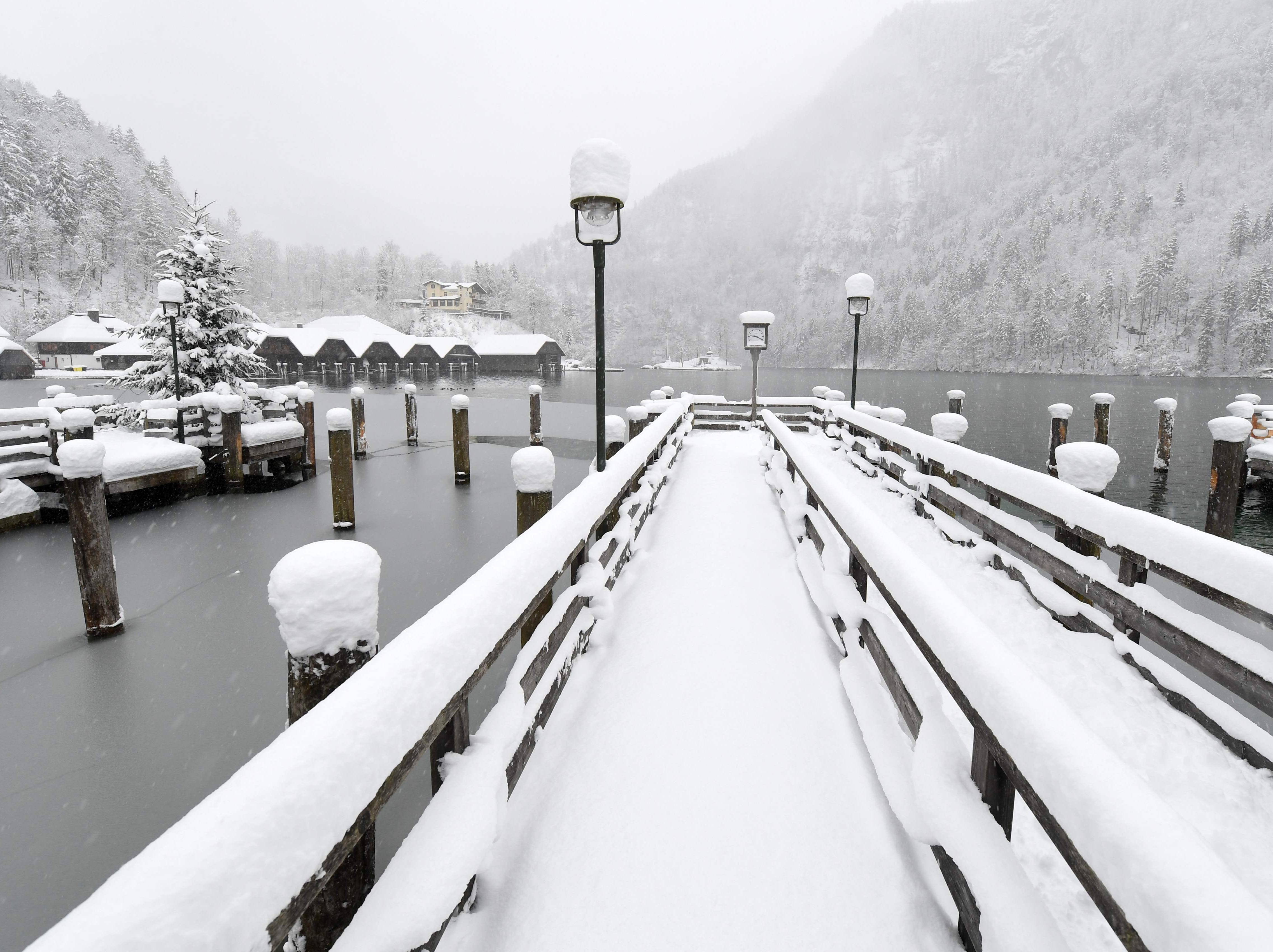 Snow covers a pier at Lake Koenigssee in Berchtesgaden, Germany.