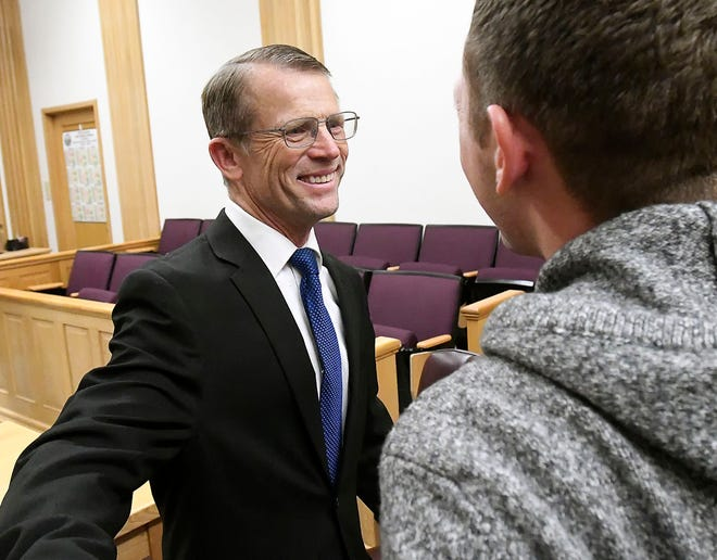 Robert Crosland smiles at son Mario Crosland after Robert was found not guilty of misdemeanor animal cruelty, Friday, Jan. 4, 2019, in Preston, Idaho. Crosland was on trial for feeding a live puppy to a snapping turtle in front of students at Preston Junior High School.