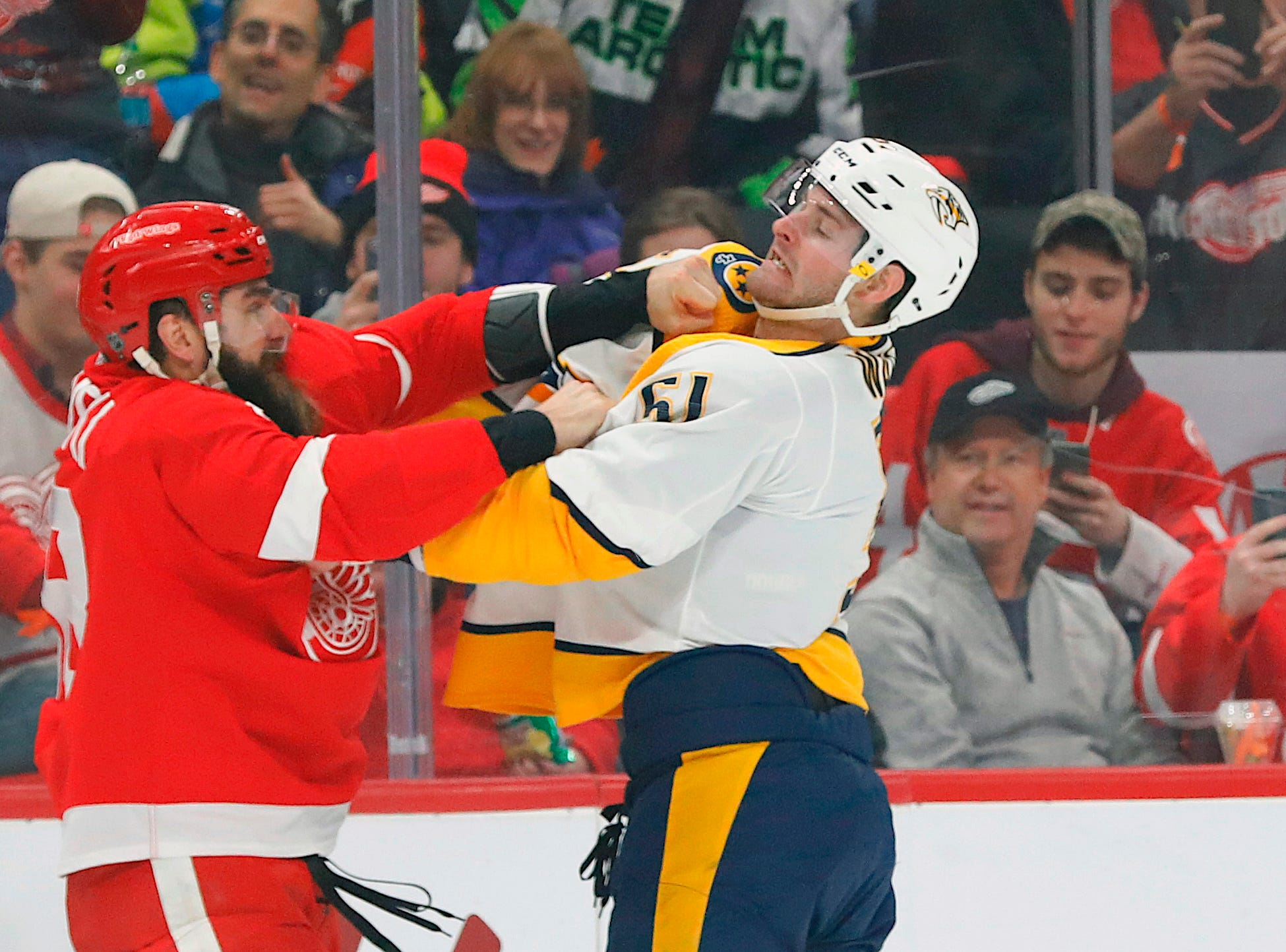 Jan. 4,: Detroit Red Wings' Luke Witkowski vs. Nashville Predators' Miikka Salomaki.