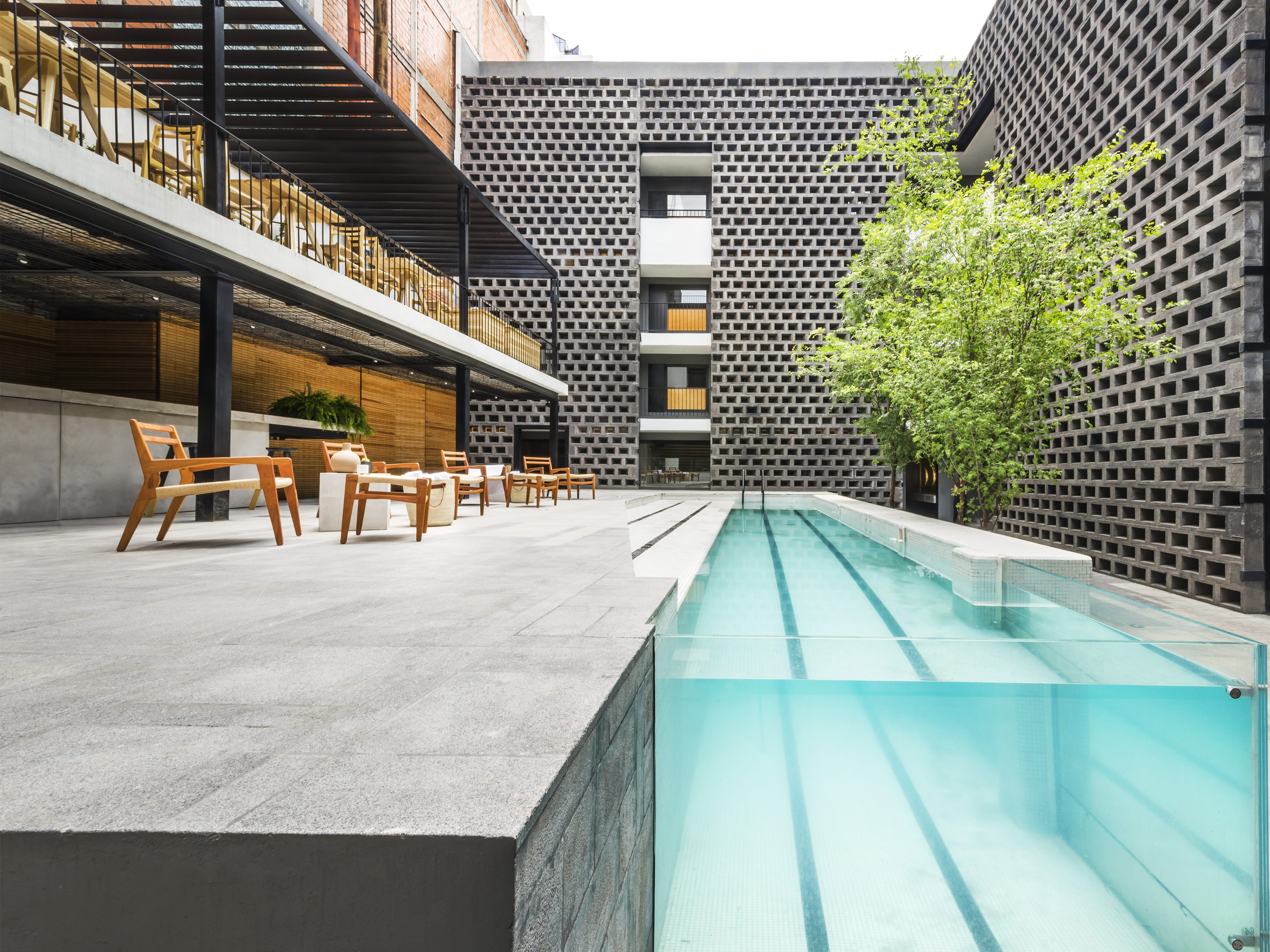 Originally dating to the 1970s, Hotel Carlota was revamped by JSa Arquitectura and completed in 2015. As part of the renovation, a pool became the focal point of the courtyard, and its modernized, streamlined design makes a dramatic statement.
