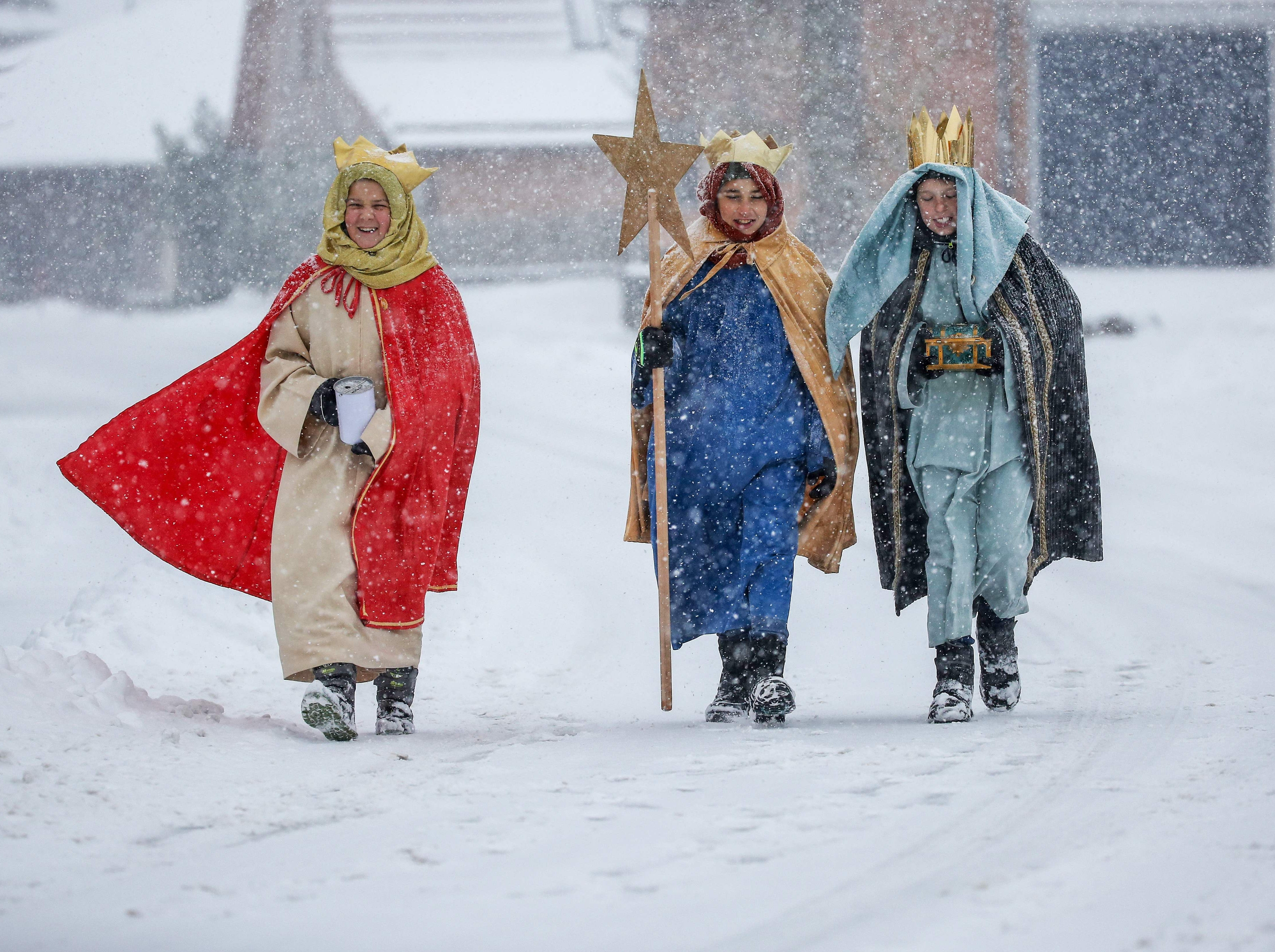 Carol singers dressed as the three Kings walk on the snow-covered path on the eve of the Epiphany celebrations on Jan. 5, 2019 in Lengenwang, Germany.