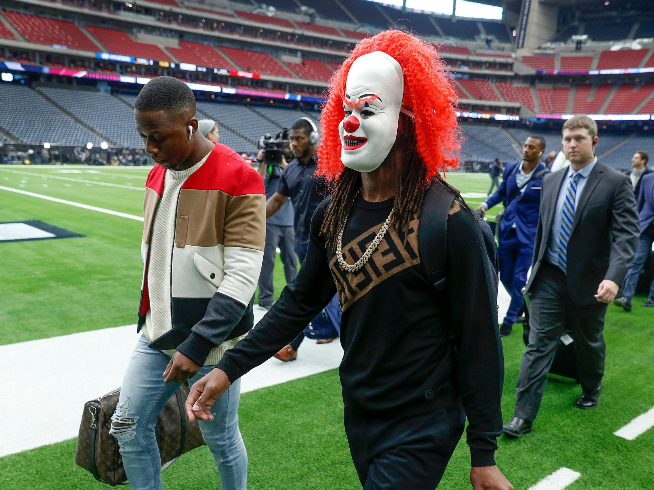 Indianapolis Colts wide receiver T.Y. Hilton (13) wears a clown mask as he and his teammates arrive for a AFC Wild Card playoff football game against the Houston Texans at NRG Stadium.
