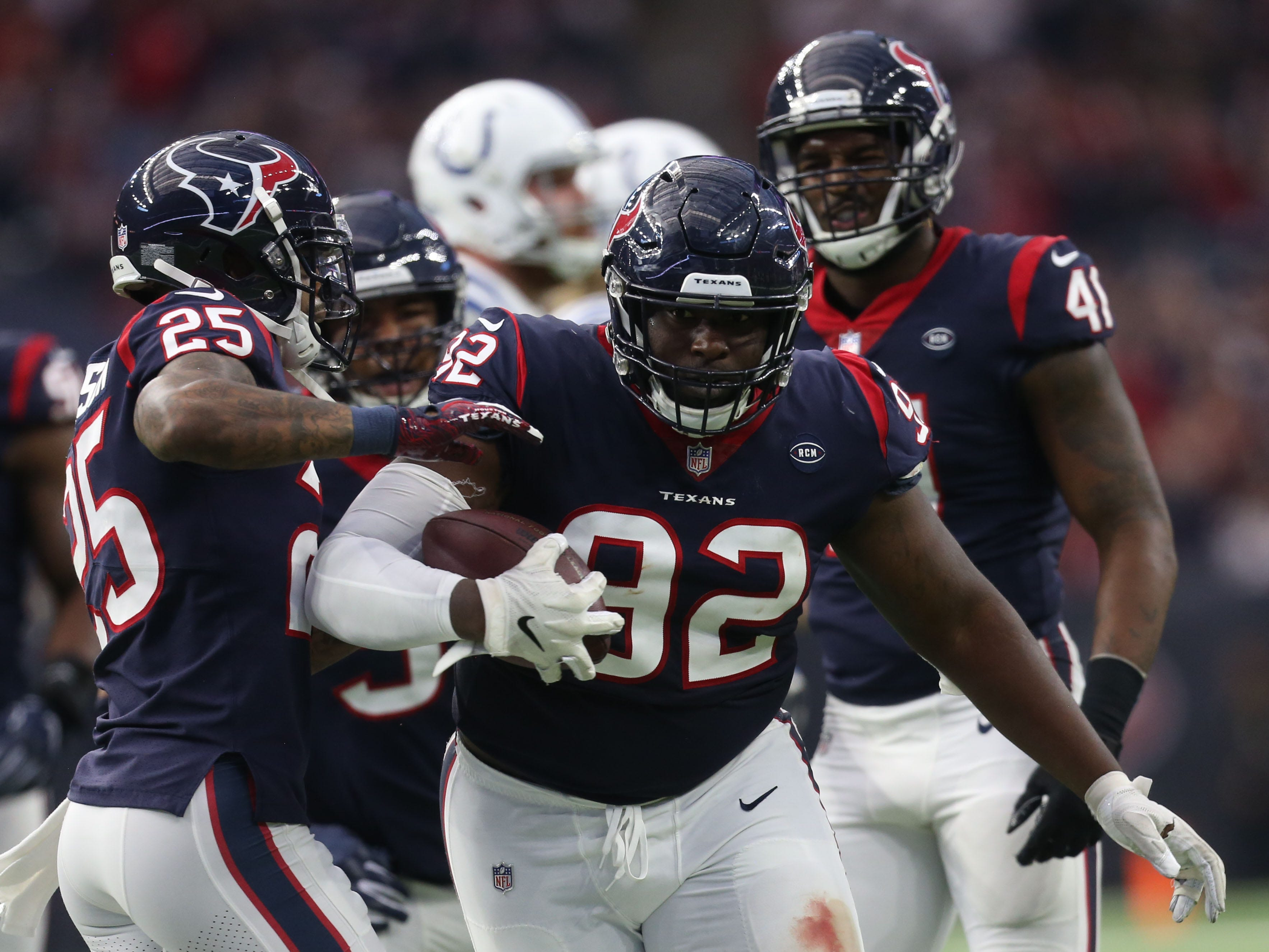 Houston Texans nose tackle Brandon Dunn (92) reacts after intercepting a pass against the Indianapolis Colts in the first half in a AFC Wild Card playoff football game at NRG Stadium.