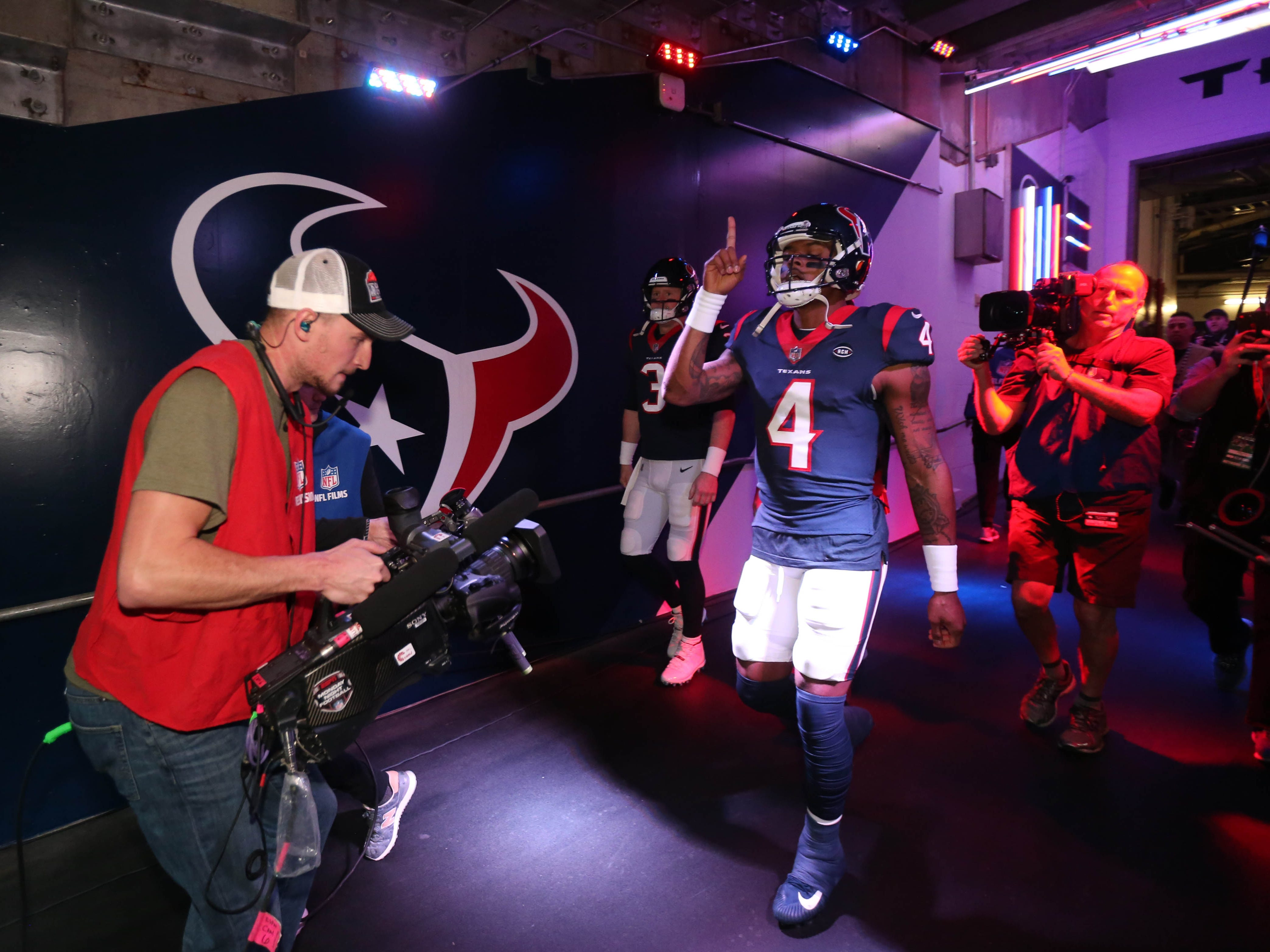 Houston Texans quarterback Deshaun Watson (4) heads to the field before a AFC Wild Card playoff football game against the Indianapolis Colts at NRG Stadium.