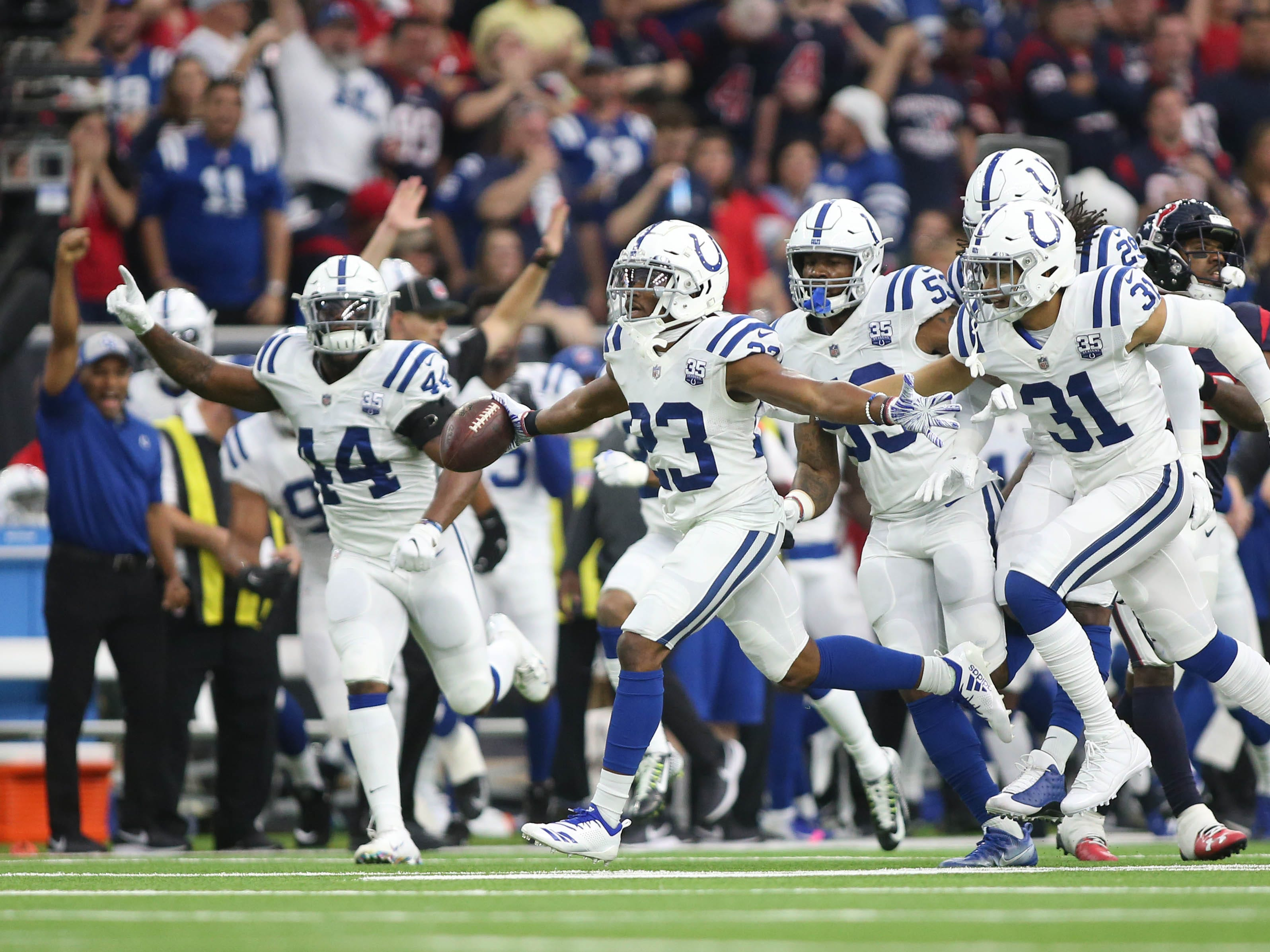 Indianapolis Colts cornerback Kenny Moore (23) reacts after an interception against the Houston Texans in the first half in a AFC Wild Card playoff football game at NRG Stadium.