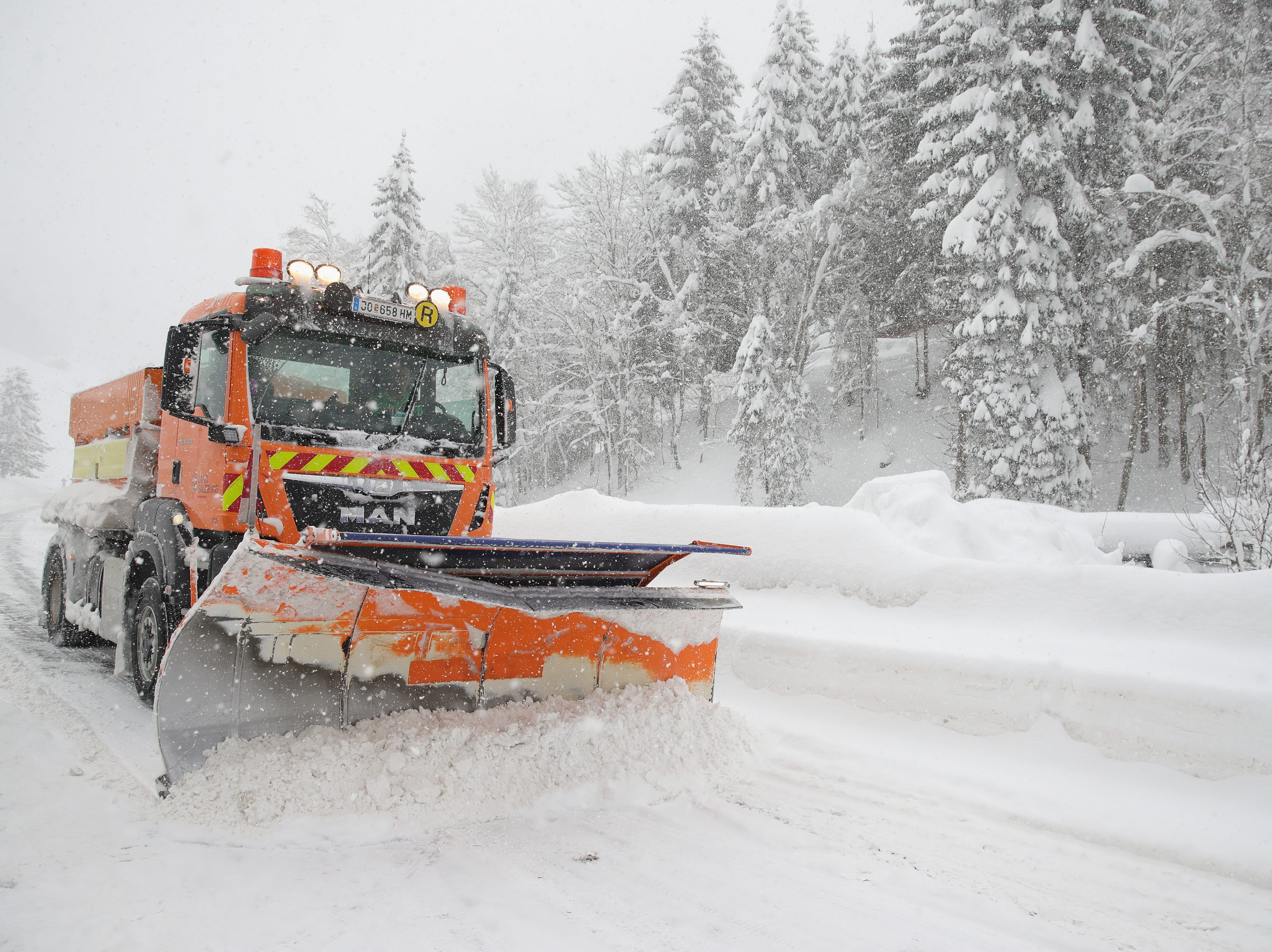 A snow plow cleans the main road out of a valley that was blocked after heavy snow falls on Jan. 5, 2019 in Filzmoos, Austria. Filzmoos is a town within the district of St. Johann im Pongau in the state of Salzburg next to the Dachstein mountain.