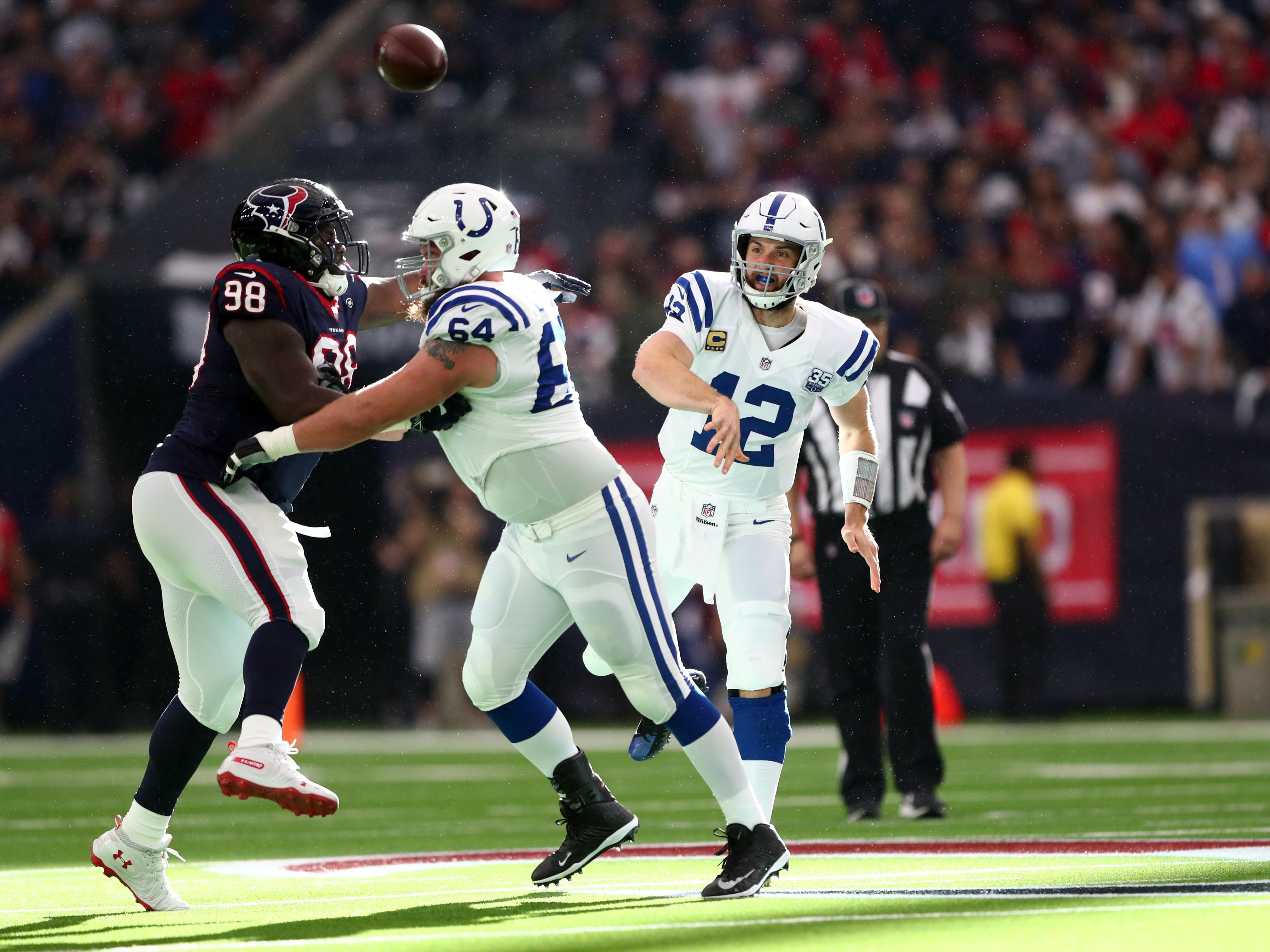 Indianapolis Colts quarterback Andrew Luck (12) throws a pass against the Houston Texans in the first quarter in a AFC Wild Card playoff football game at NRG Stadium.