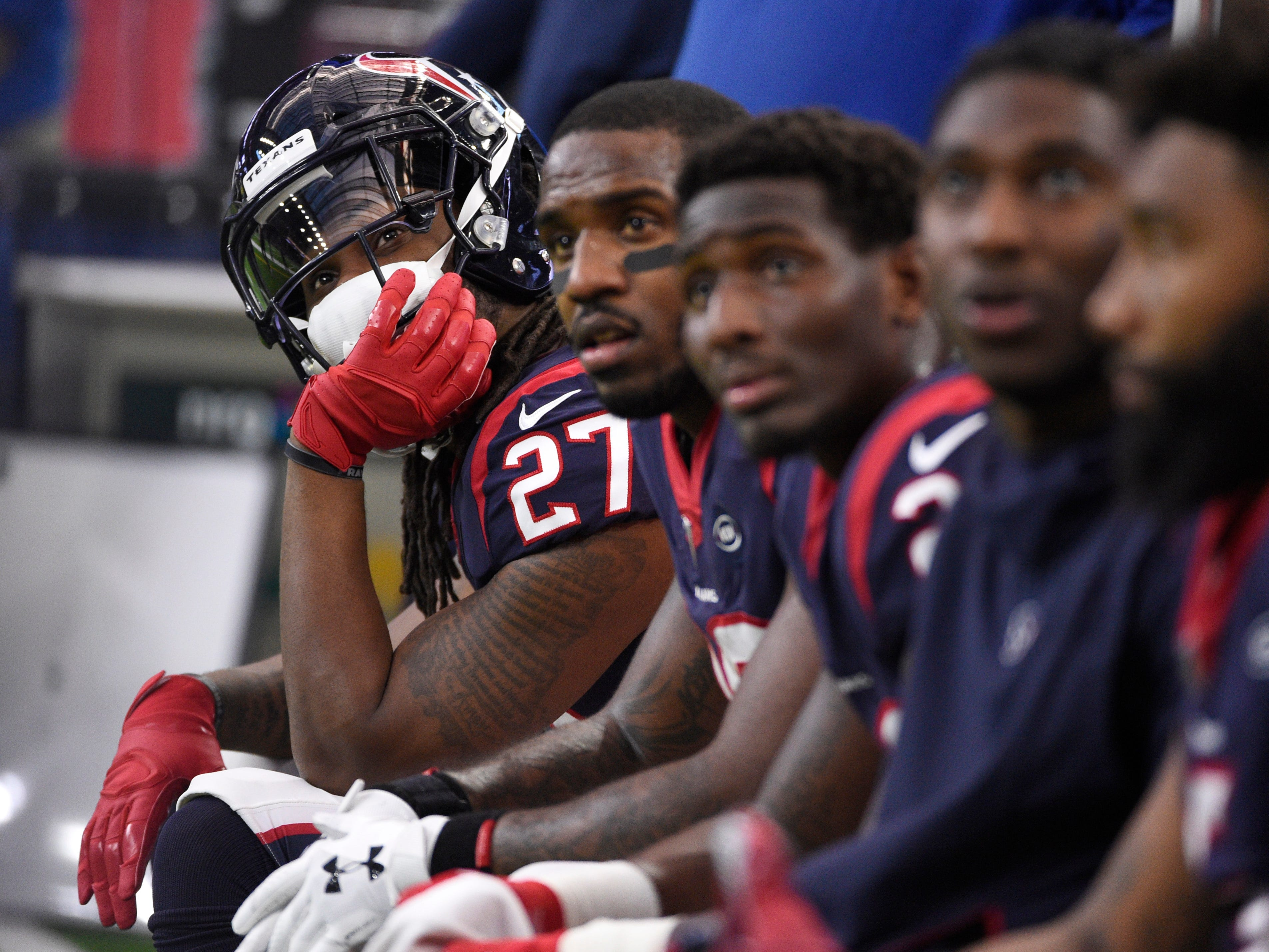 Houston Texans running back D'Onta Foreman (27) sit on the bench with teammates during the first half of an NFL wild card playoff football game against the Indianapolis Colts, Saturday, Jan. 5, 2019, in Houston. (AP Photo/Eric Christian Smith) ORG XMIT: TXEG130