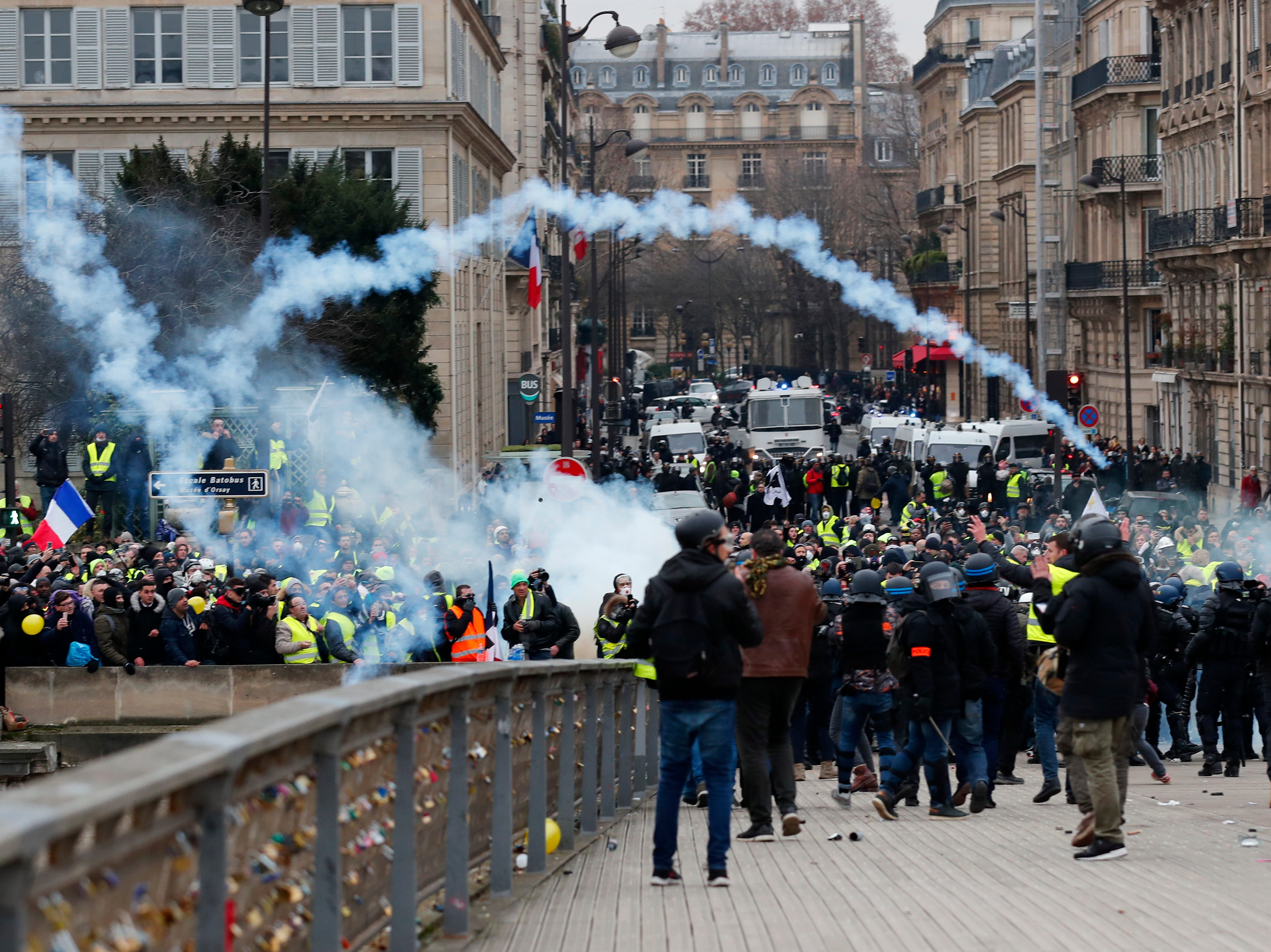 French riot police clashes with protesters as they try to cross the Seine river during a 'Yellow Vests' protest in Paris, France on Jan. 5, 2019.