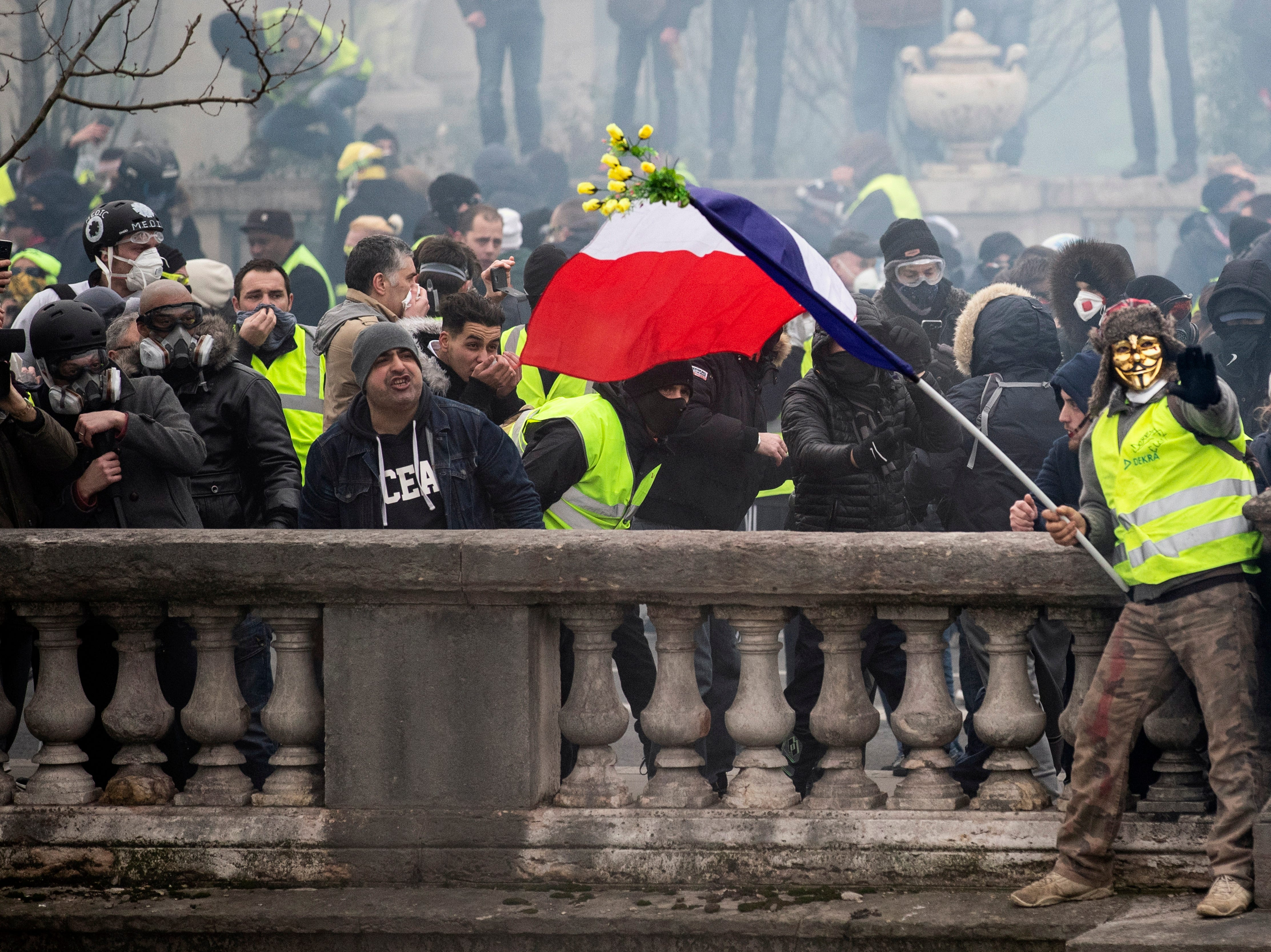 Protesters try to cross bridges over the Seine river during a 'Yellow Vests' protest in Paris, France on Jan. 5, 2019. The so-called 'gilets jaunes' (yellow vests) is a grassroots protest movement with supporters from a wide span of the political spectrum, that originally started with protest across the nation in late 2018 against high fuel prices. The movement in the meantime also protests the French government's tax reforms, the increasing costs of living and some even call for the resignation of French president Emmanuel Macron.