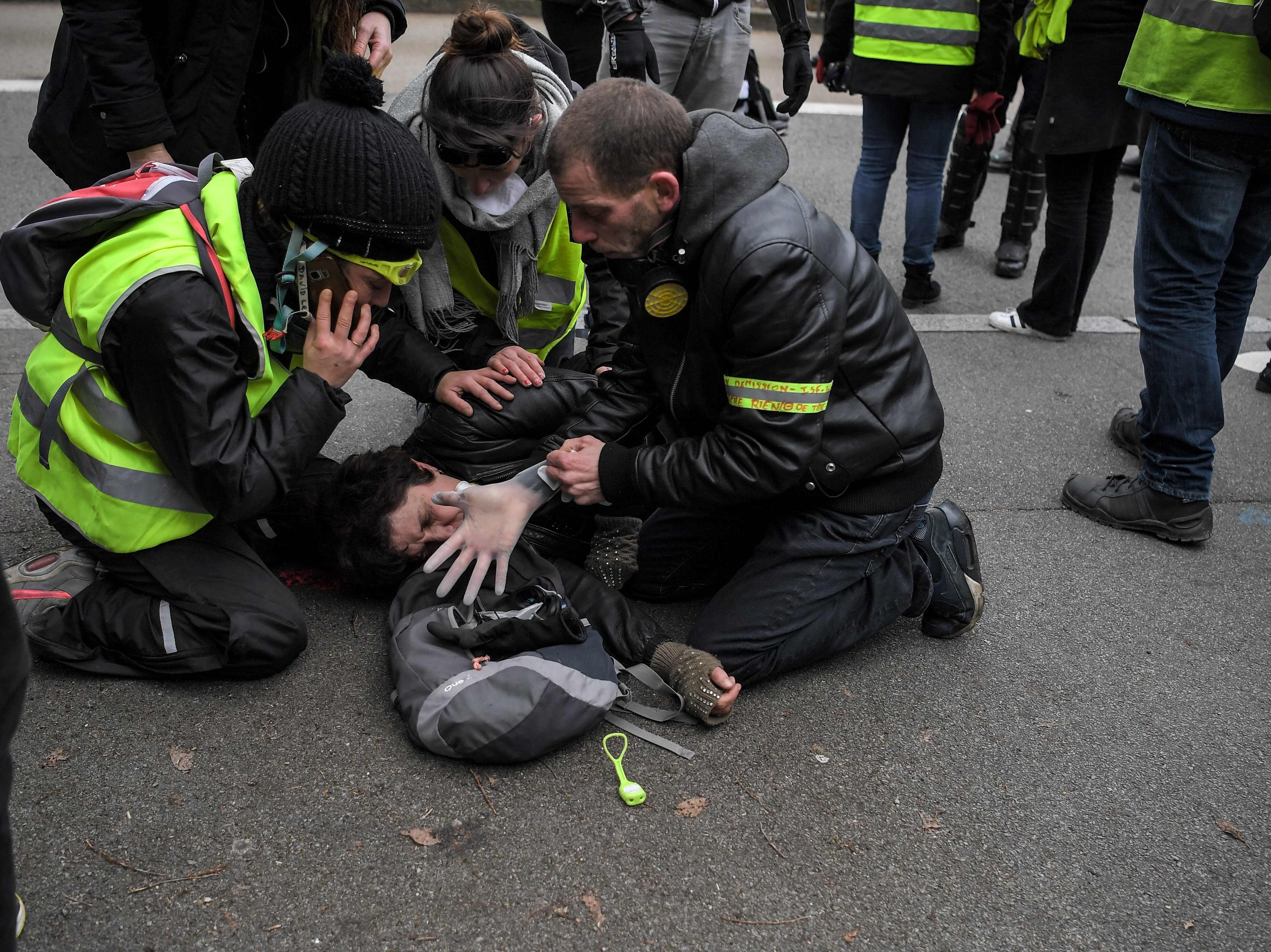 "A ""Yellow Vest"" (Gilets jaunes) anti-government protester is attended by others after being injured during a rally in Nantes on Jan. 5, 2019, part of a nationwide day of demonstrations."