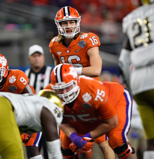 Clemson quarterback Trevor Lawrence stands at the line of scrimmage against Notre Dame during the 2018 Cotton Bowl.