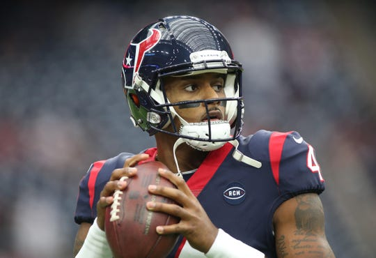 Houston Texans quarterback Deshaun Watson (4) warms up before a AFC Wild Card playoff football game against the Indianapolis Colts at NRG Stadium.