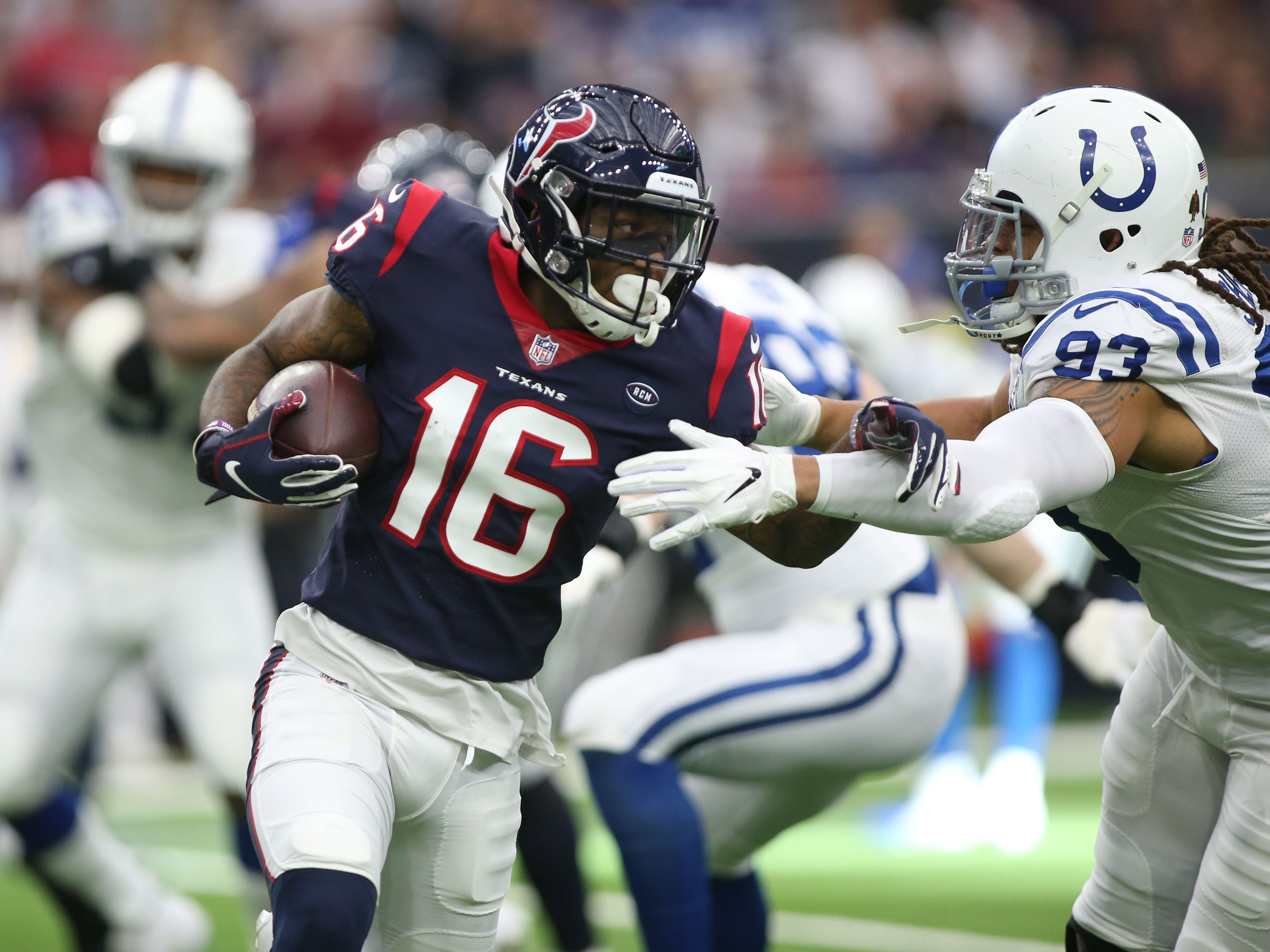 Houston Texans wide receiver Keke Coutee (16) runs the ball against Indianapolis Colts defensive end Jabaal Sheard (93) in the first quarter in a AFC Wild Card playoff football game at NRG Stadium.